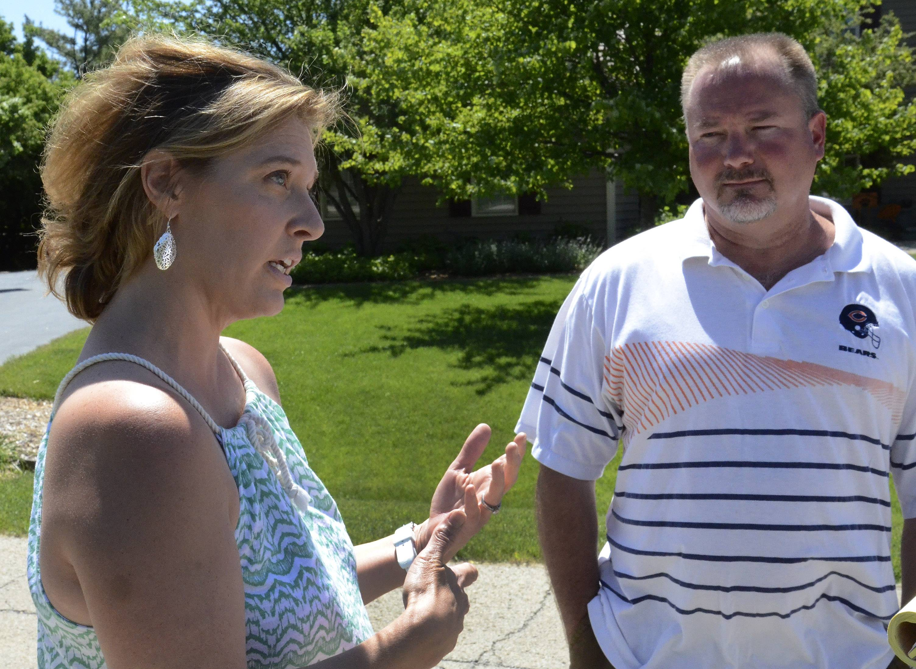 Stephanie Huffman and Todd Larak are concerned about a proposal for a 150-foot cellular tower near their houses in Libertyville Township. The proposal has been withdrawn for the time being.