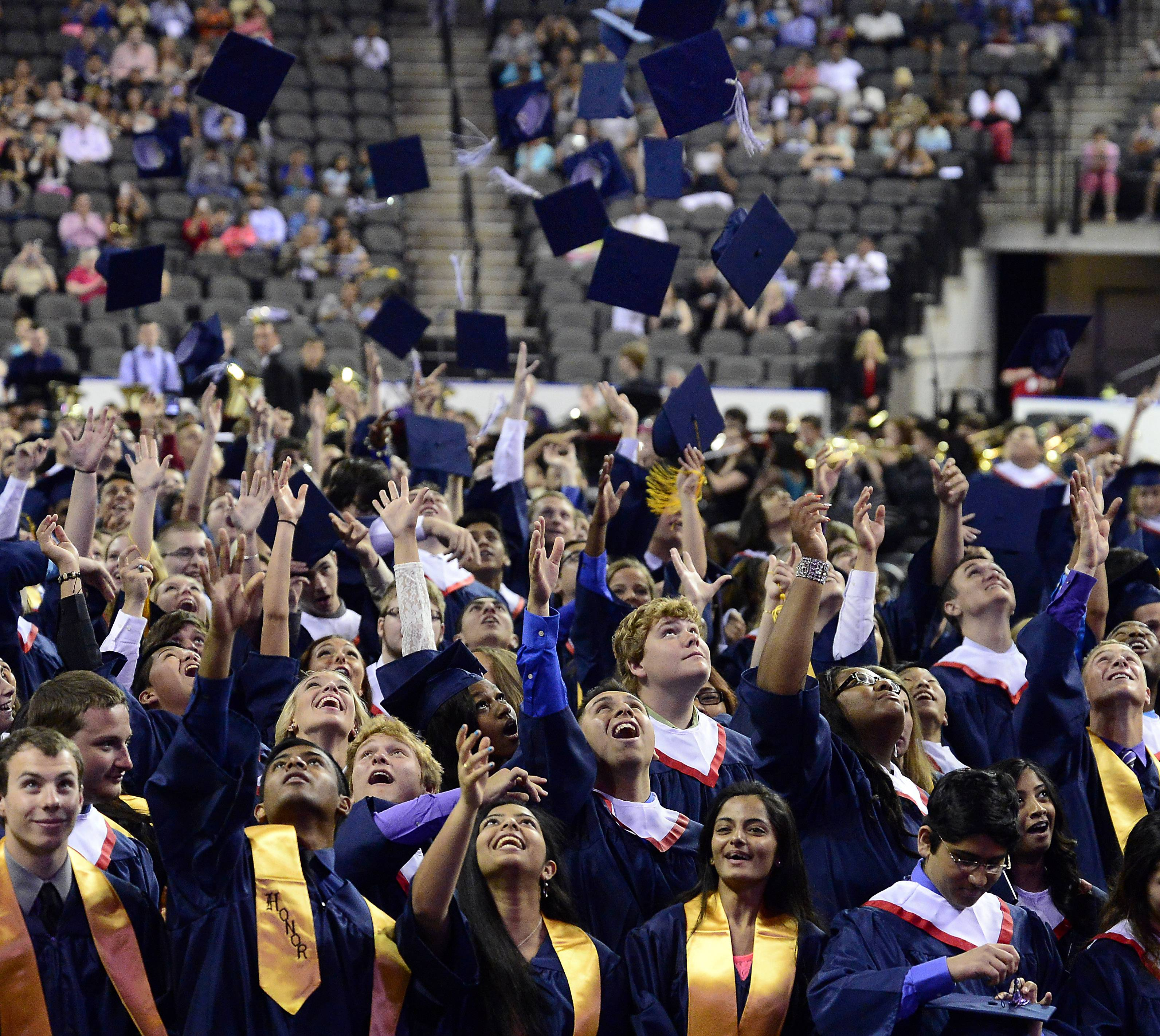 Mark Welsh/mwelsh@dailyherald.comThe graduation caps fly as Conant says goodbye to their four years of high school as their 49th annual commencement comes to an end at the Sears Centre on Sunday.