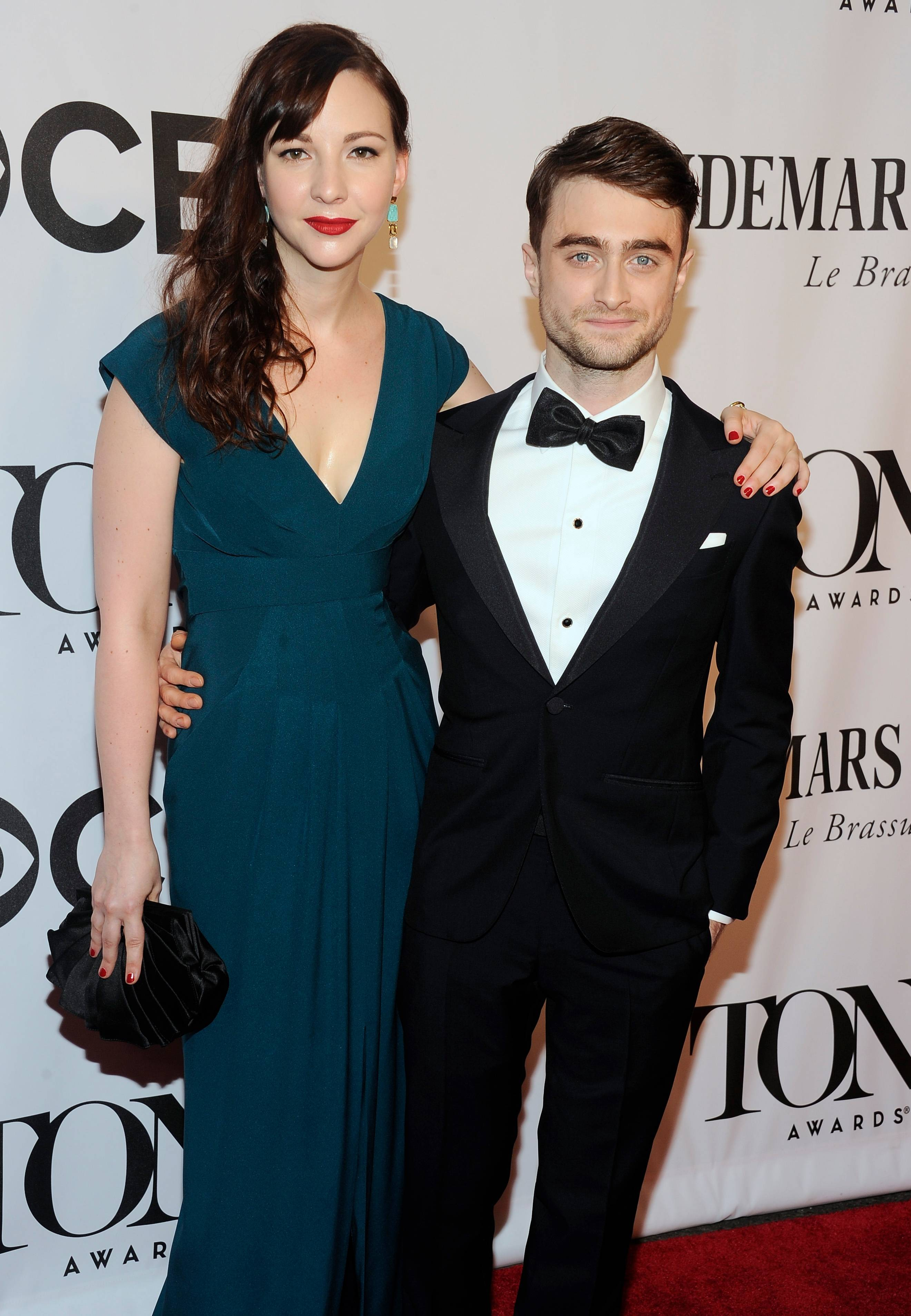 "Daniel Radcliffe, who is currently starring in ""The Cripple of Inishmaan"" walks the red carpet with Erin Darke at the 68th annual Tony Awards at Radio City Music Hall on Sunday."