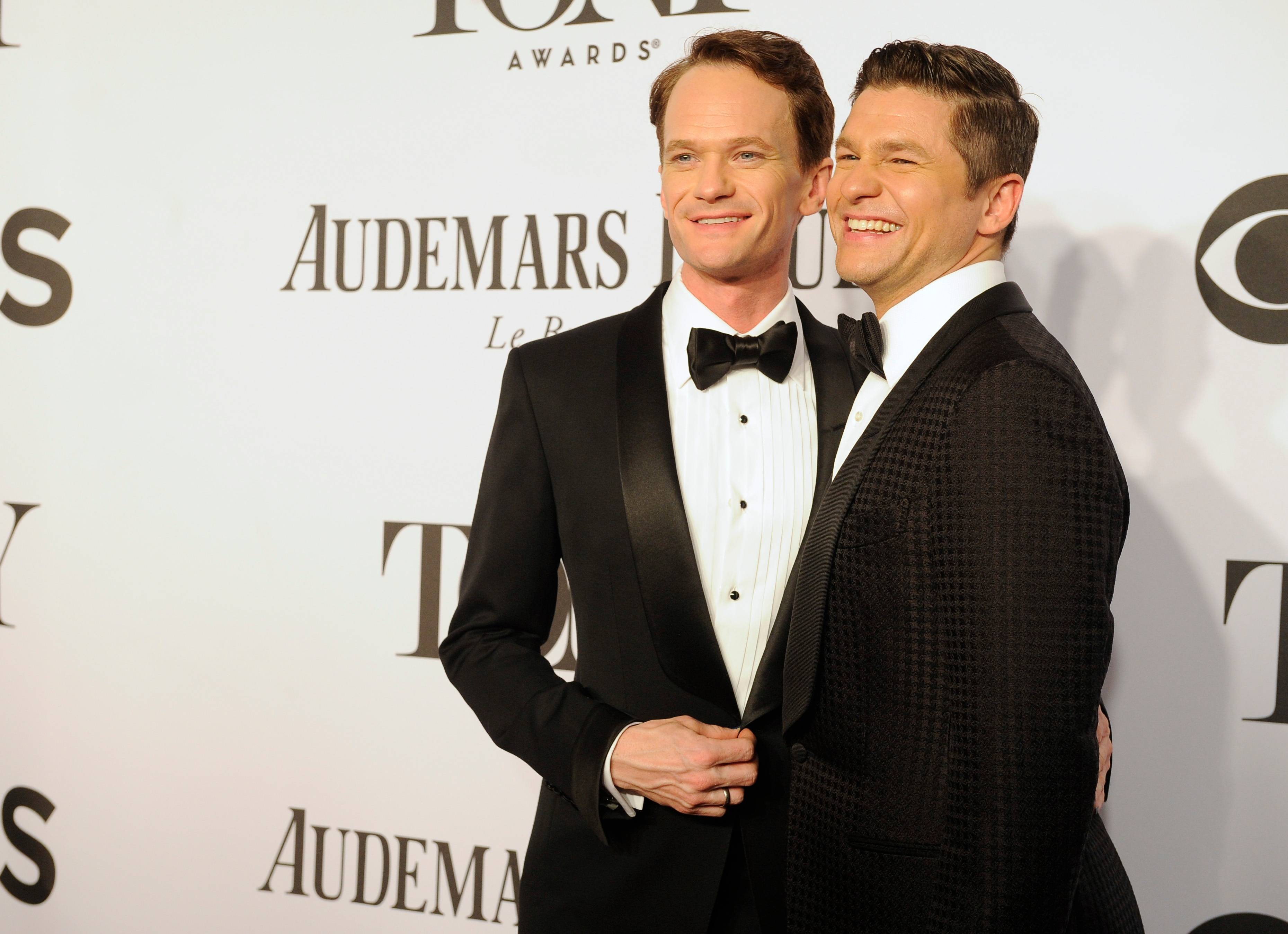 "Last year's Tony host and this year's nominee for ""Hedwig and the Angry Inch"" Neil Patrick Harris, left, arrives with his husband, David Burtka, at the 68th annual Tony Awards at Radio City Music Hall on Sunday in New York."