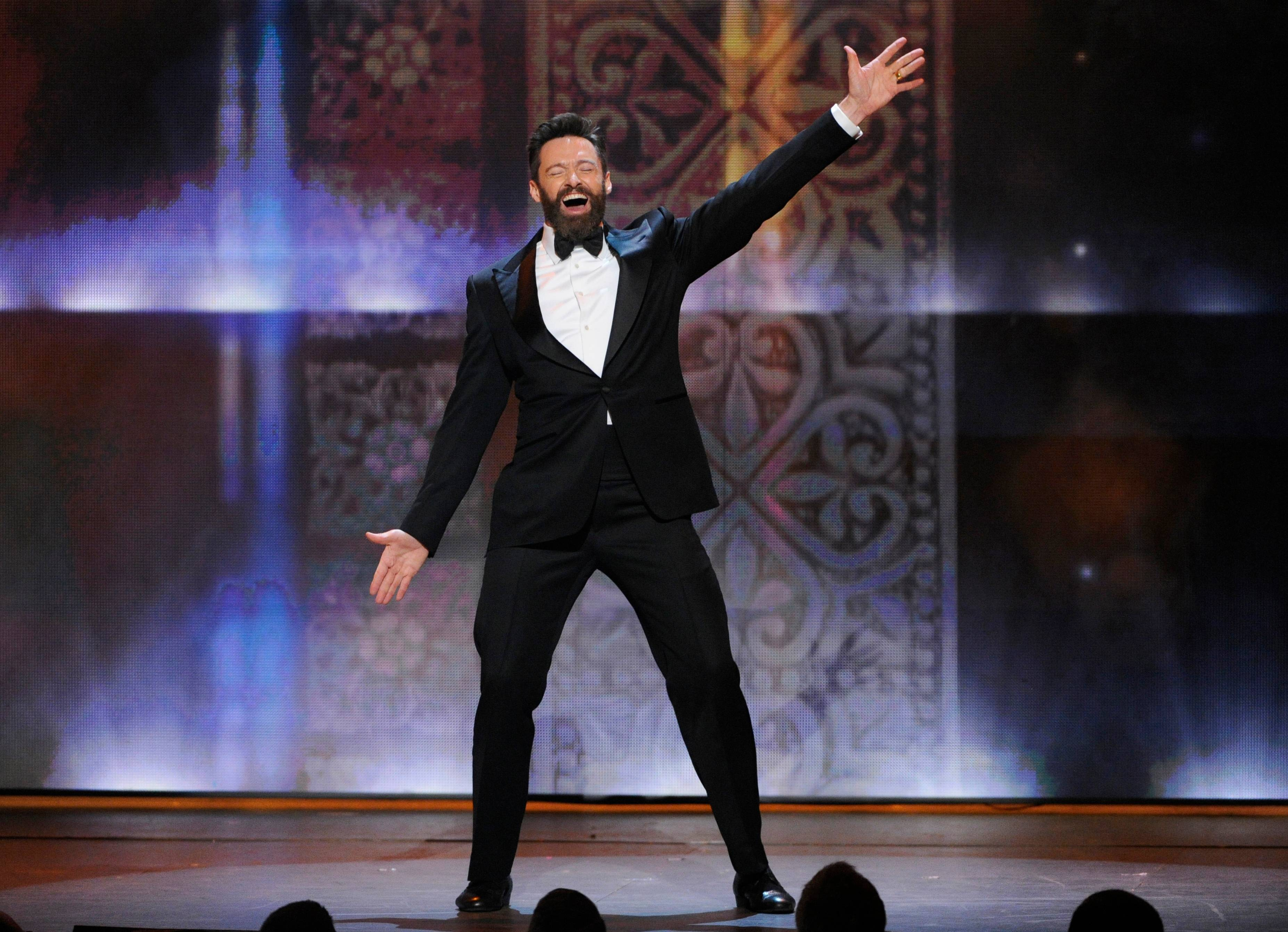 Host Hugh Jackman performs during the opening of at the 68th annual Tony Awards at Radio City Music Hall on Sunday.