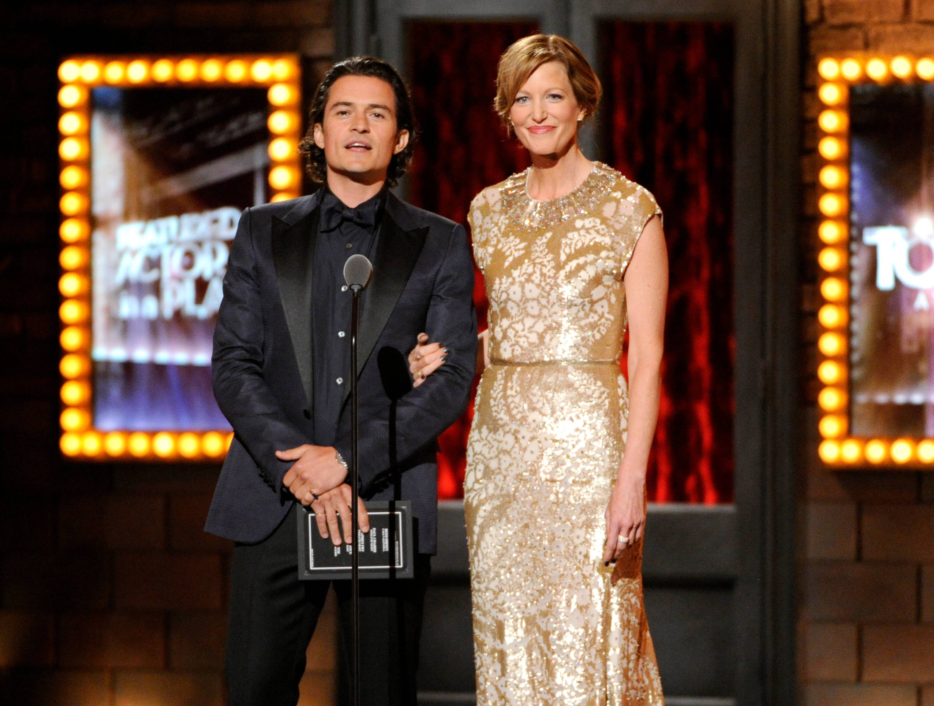 Orlando Bloom and Anna Gunn speak onstage at the 68th annual Tony Awards at Radio City Music Hall on Sunday.