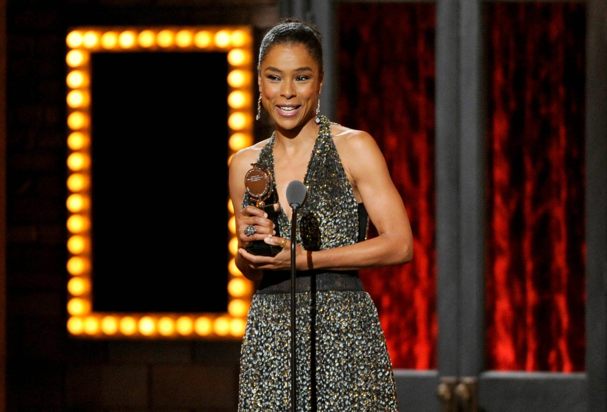 "Sophie Okonedo accepts the award for best performance by an actress in a featured role in a play for ""A Raisin in the Sun"" on stage at the 68th annual Tony Awards."