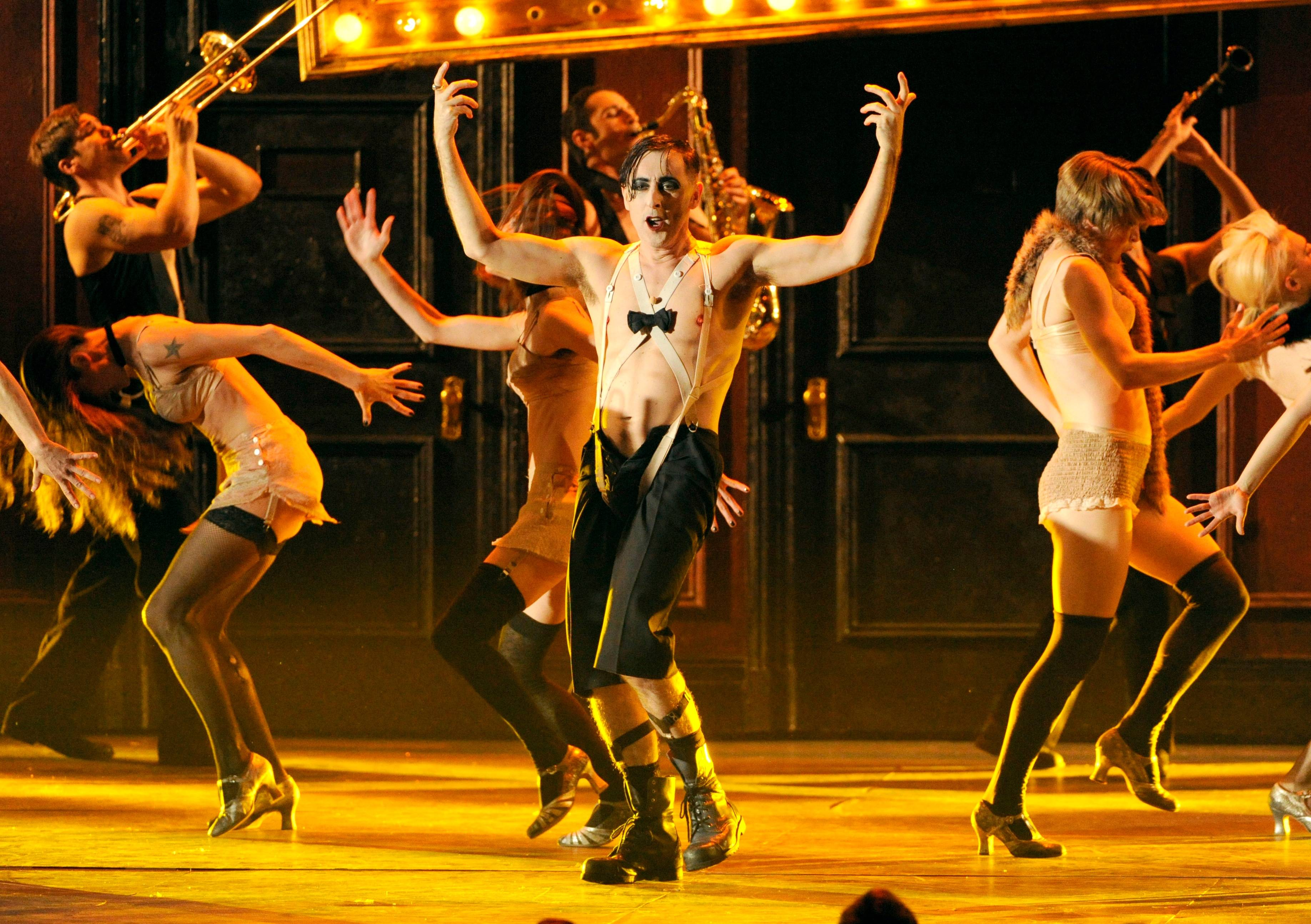 "Alan Cumming, center, and the cast of ""Cabaret"" perform on stage at the 68th annual Tony Awards."