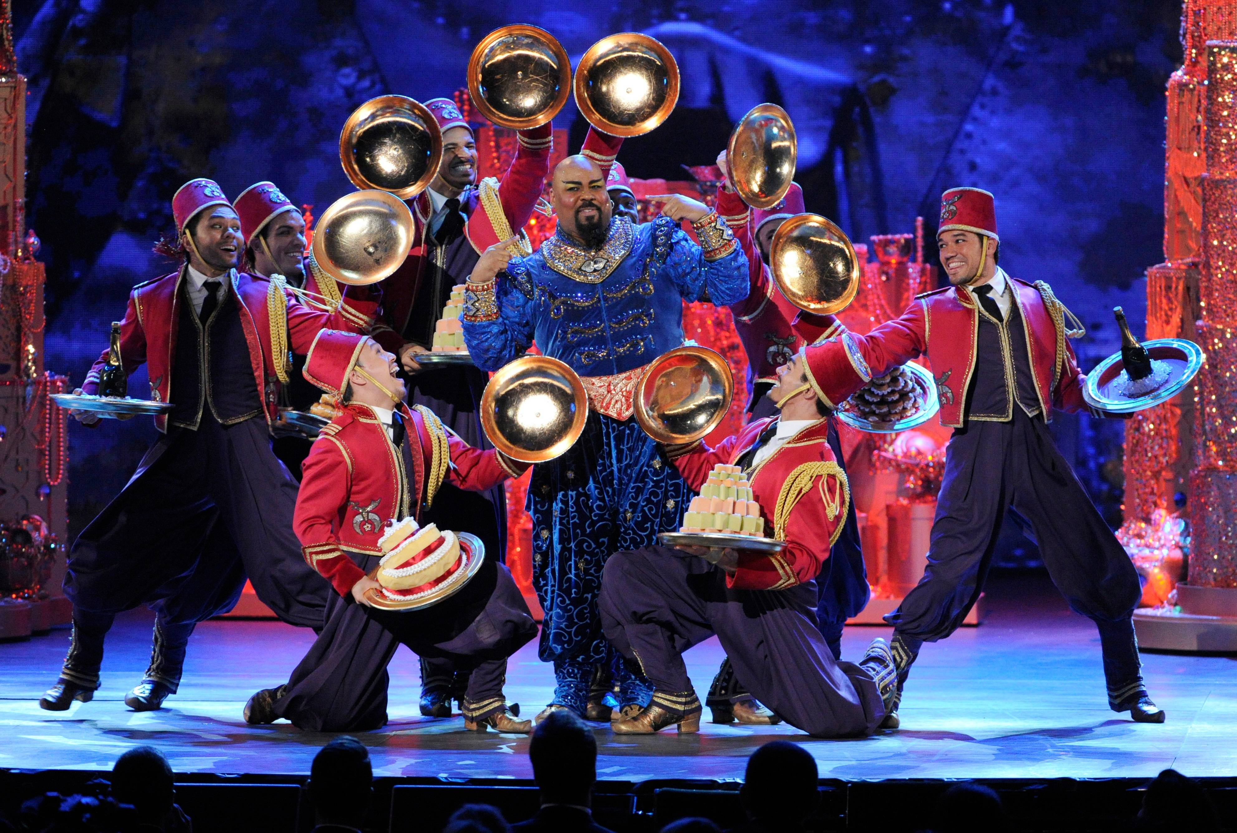 "James Monroe Iglehart, center, and the cast of ""Aladdin"" perform on stage at the 68th annual Tony Awards at Radio City Music Hall on Sunday."