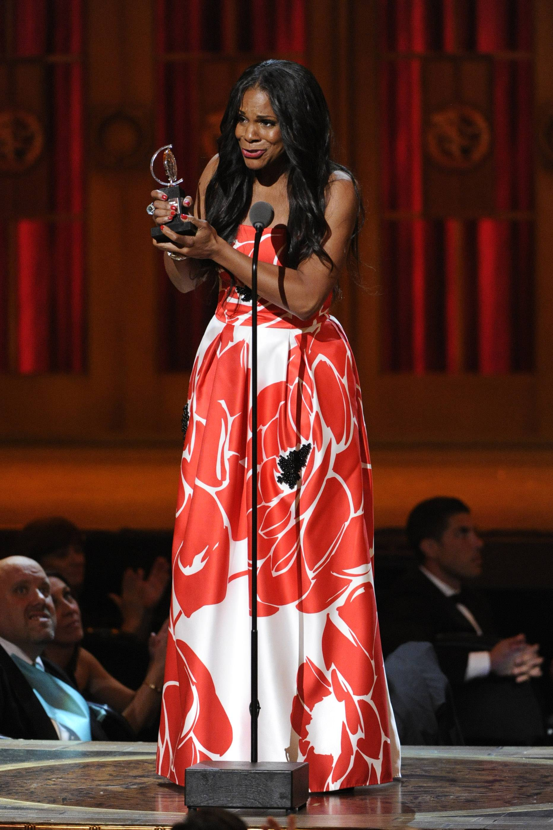 "Audra McDonald accepts the award for best performance by an actress in a leading role in a play for ""Lady Day at Emerson's Bar & Grill"" on stage at the 68th annual Tony Awards at Radio City Music Hall on Sunday."
