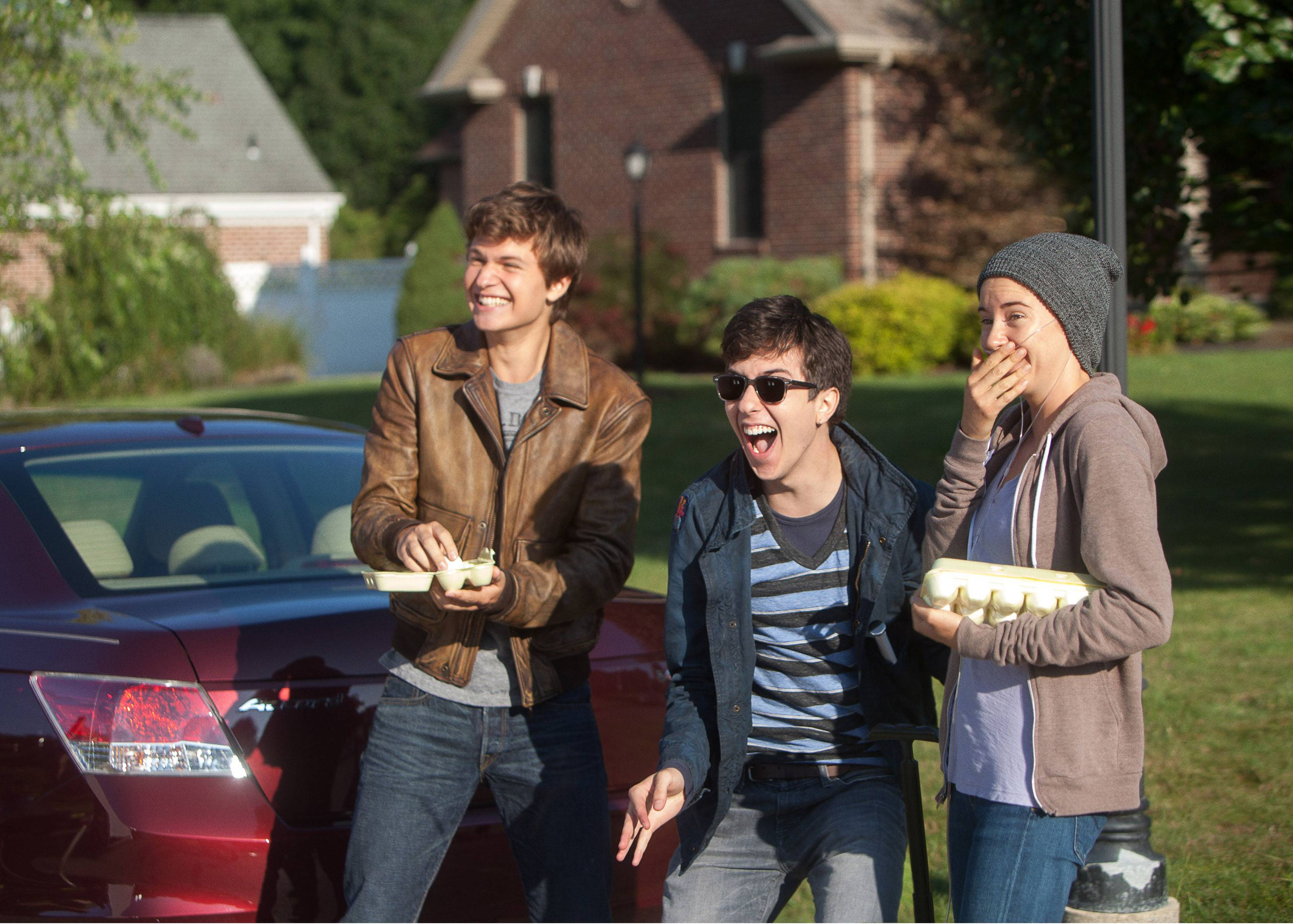 "Ansel Elgort, left, Nat Wolff, and Shailene Woodley star in the adaptation of Green's book, ""The Fault In Our Stars."""