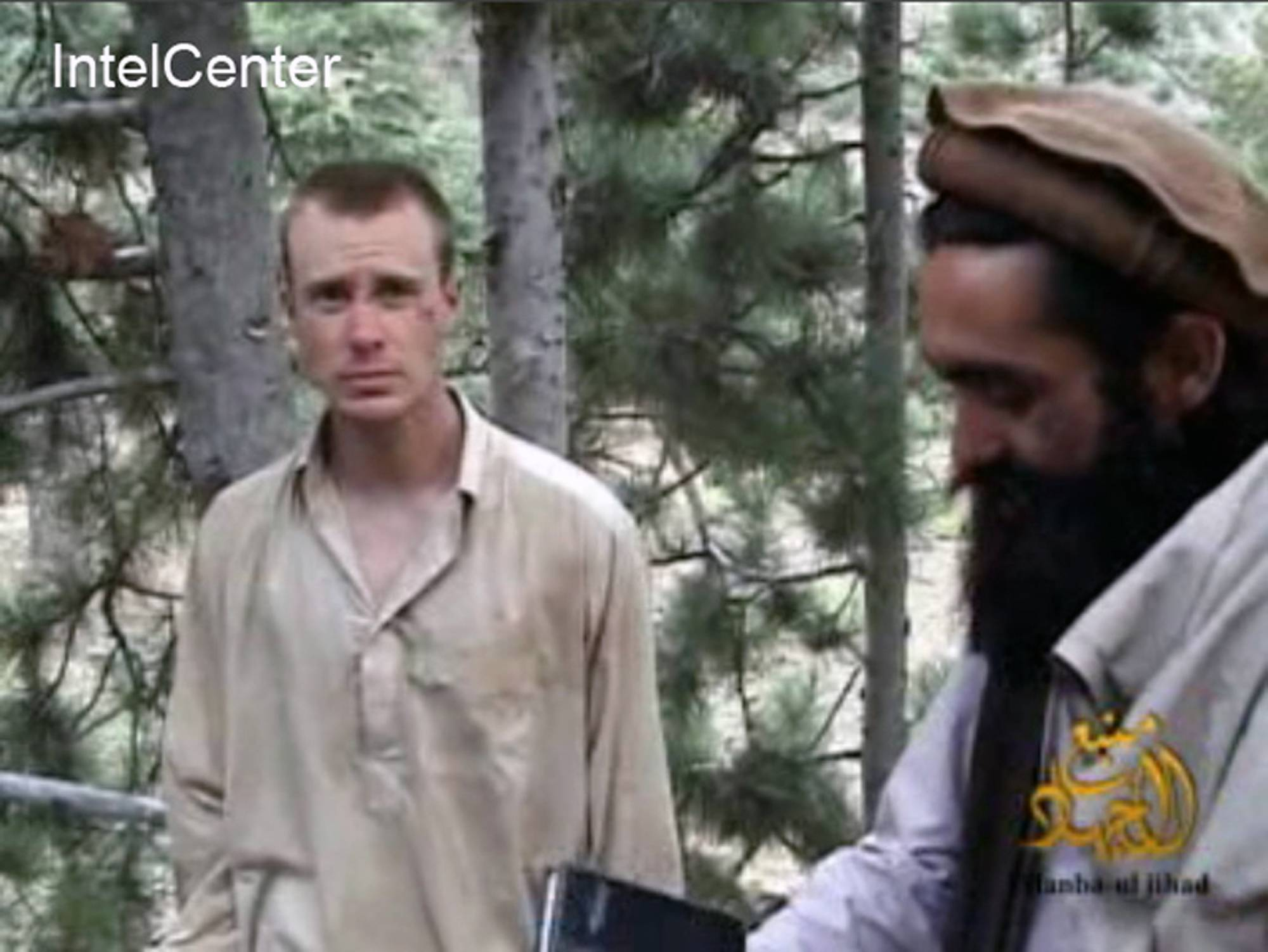 This image made from video released by the Taliban shows a man believed to be Bowe Bergdahl at left. Bergdahl, a U.S. Army soldier, went missing from his outpost in Afghanistan in June 2009 and was released from Taliban captivity on May 31 in exchange for five enemy combatants held in the U.S. prison in Guantanamo Bay, Cuba.