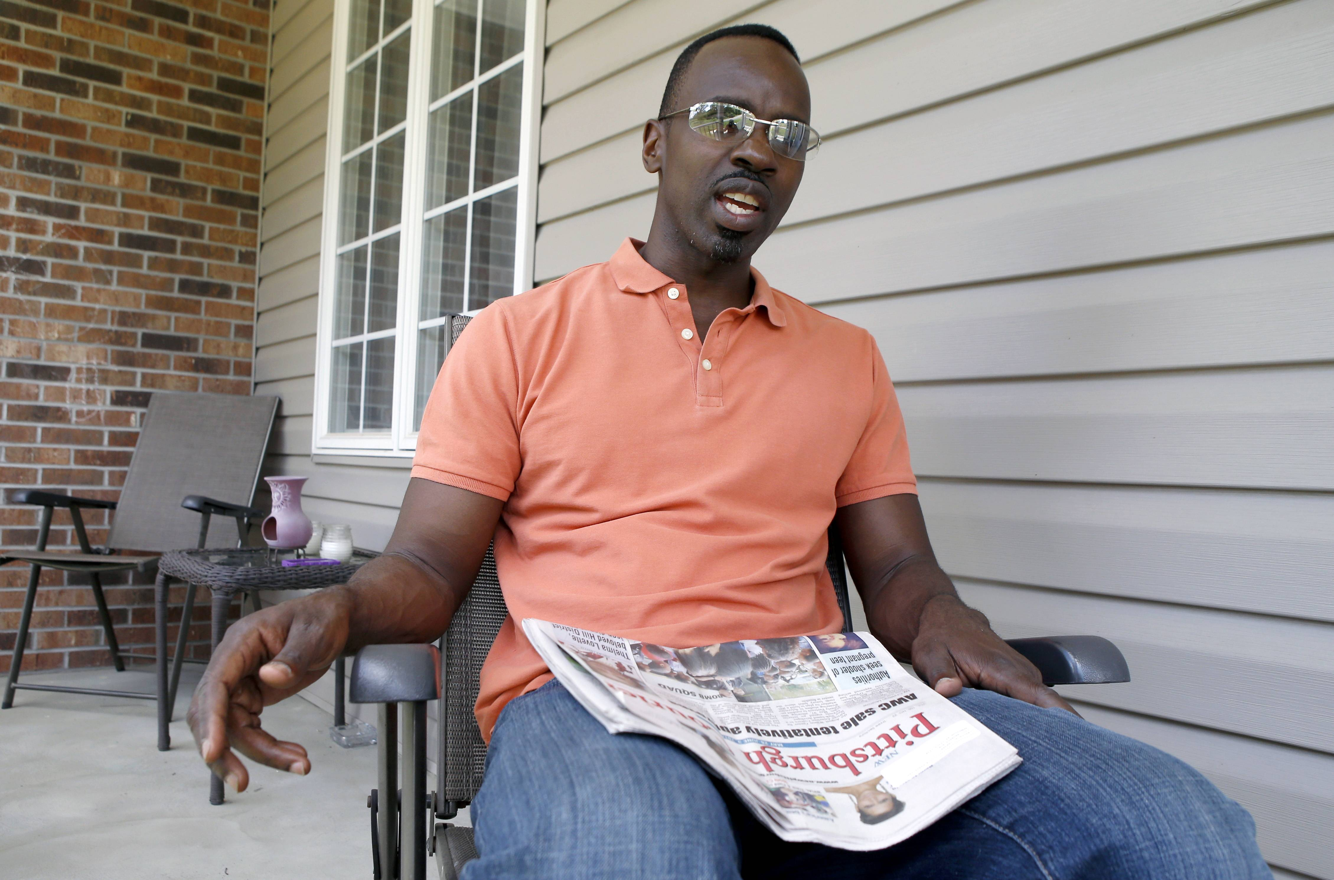 Carlos Carter talks about the feelings he had at the time of the O.J. Simpson arrest, trial and decision 20 years-ago while sitting on his porch in Ambridge, Pa. Polls show that 20 years after Simpson's case captivated and divided the nation, few opinions about the saga have changed.