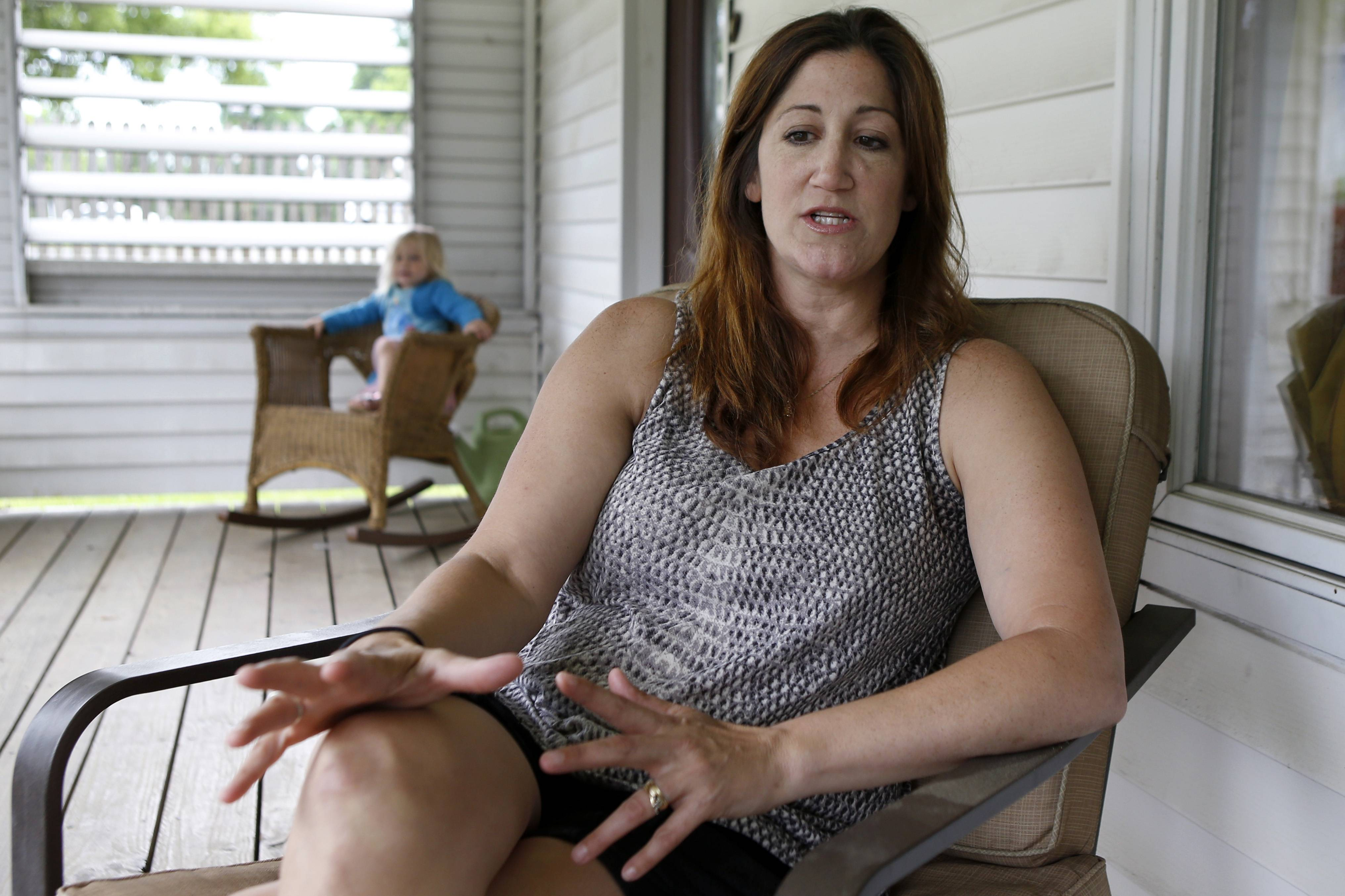 "Shannon Spicker, right, sits on her porch beside her daughter Maryana, 2, in Coraopolis, Pa. and talks about the feelings she had at the time of the O.J. Simpson arrest, trial and decision 20 years-ago. Spicker said ""Most of us didn't understand why it was racially charged."""