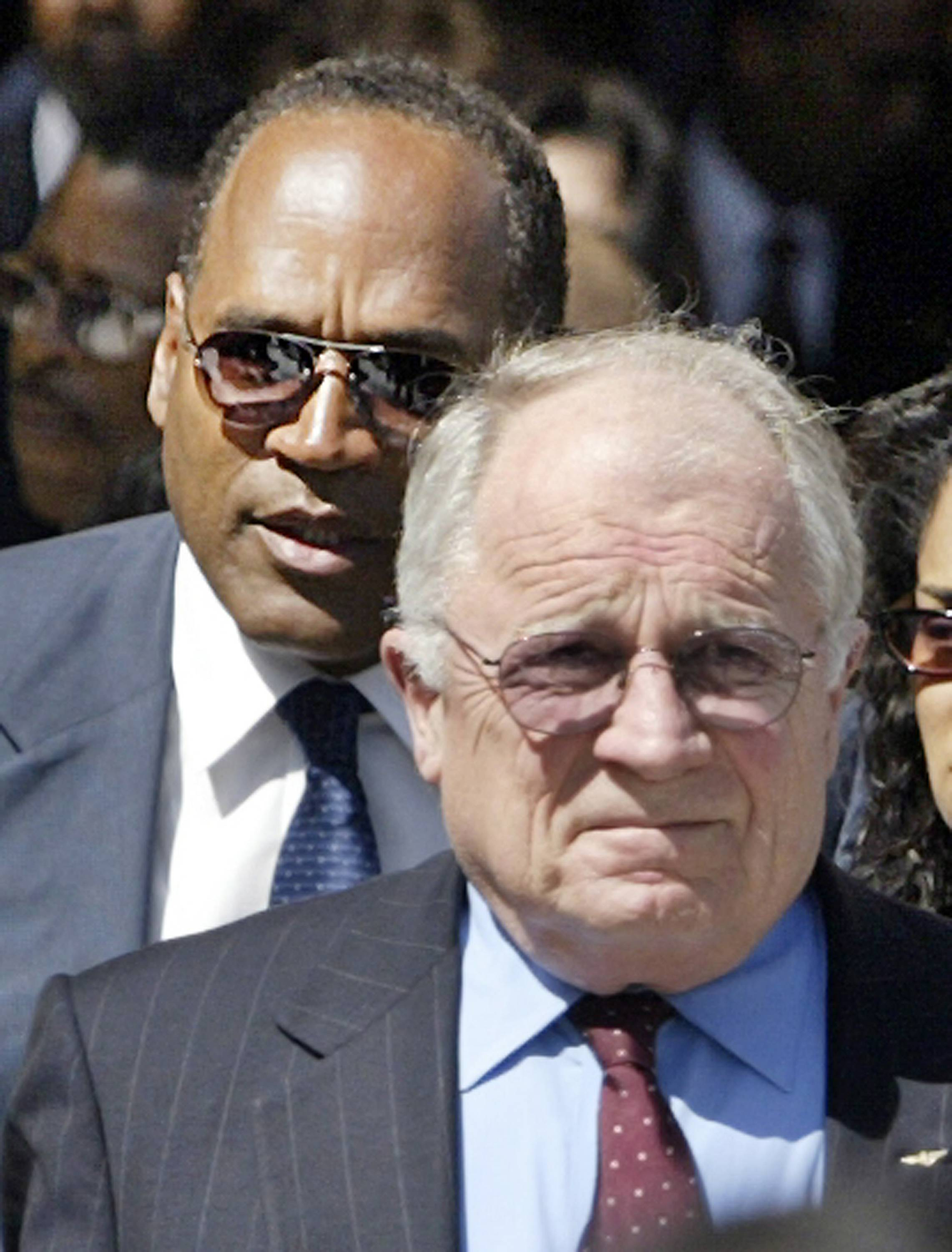 "O.J. Simpson, who was acquitted of murder charges when represented by Johnnie L. Cochran Jr., follows attorney F. Lee Bailey, another member of Simpson's ""dream team,"" as they leave the funeral service of the famed attorney at West Angeles Cathedral in Los Angeles' Crenshaw District. Bailey was a part-time member of the team but distinguished himself by finding crucial evidence to unmask police detective Mark Fuhrman as a racist. Bailey later was disbarred in Massachusetts and Florida for misconduct in the handling of a client's case."