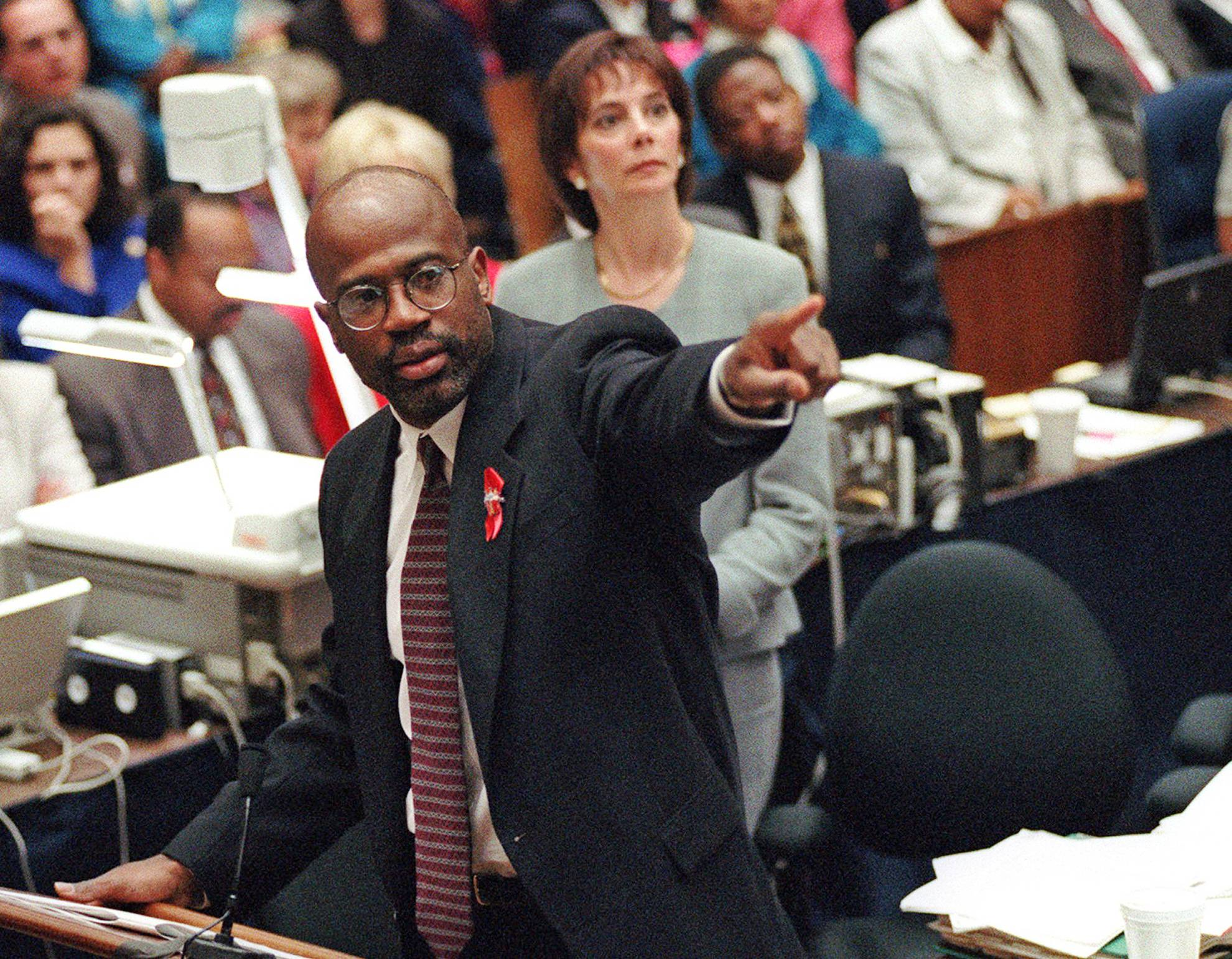 Prosecutor Christopher Darden points at a chart during his closing arguments as co-prosecutor Marcia Clark looks on in a Los Angeles courtroom during the O.J. Simpson double-murder trial. Darden, the co-prosecutor who was criticized for having Simpson try on the so-called murder gloves, left the district attorney's office following the trial.