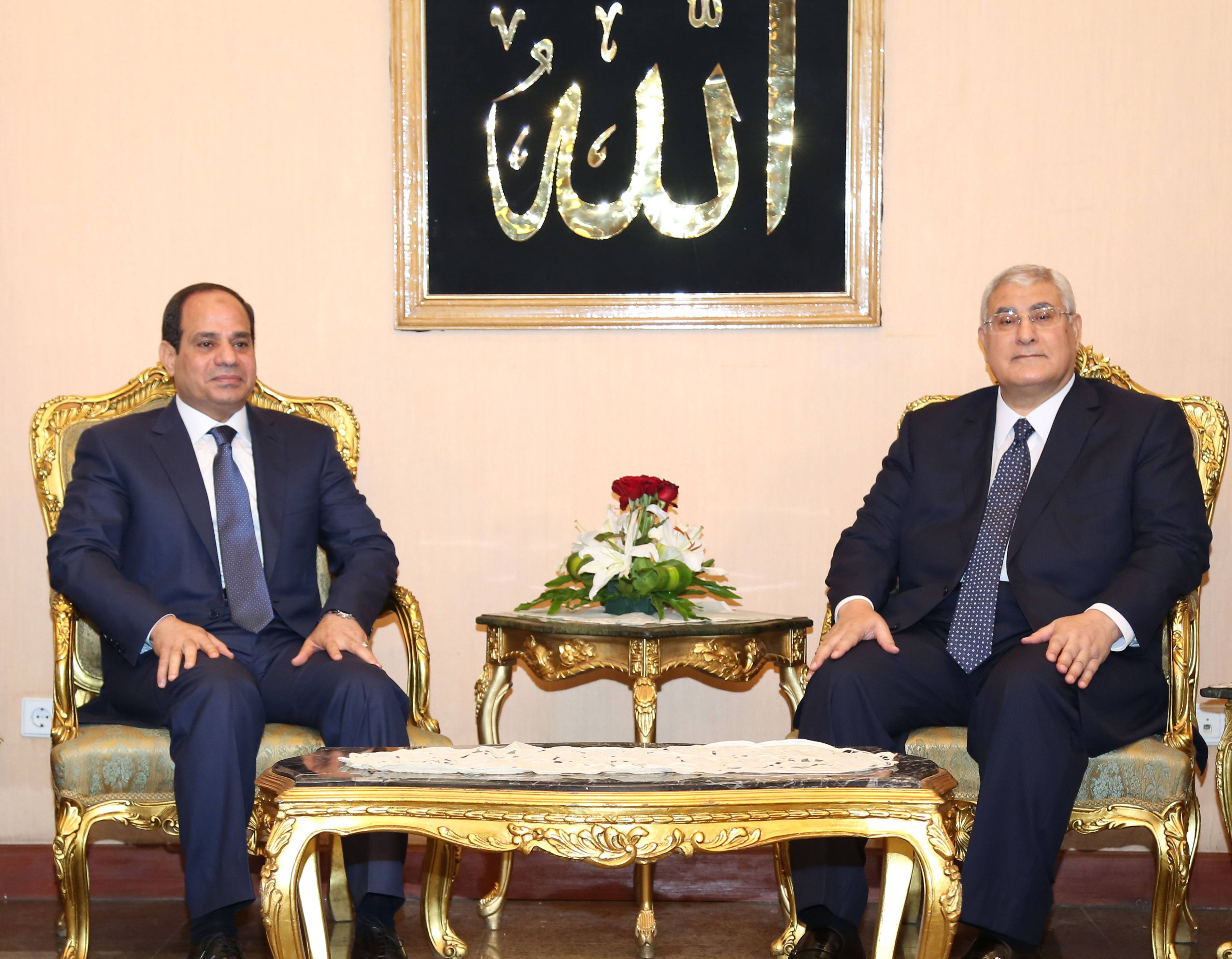 Egypt's former military chief Abdel-Fattah el-Sissi, left, and outgoing interim President Adly Mansour pose Sunday for a photo on el-Sissi's inauguration day in Cairo, Egypt. El-Sissi was sworn in on Sunday as president for a four-year term, taking the reins of power in a nation roiled since 2011 by deadly unrest and economic woes.
