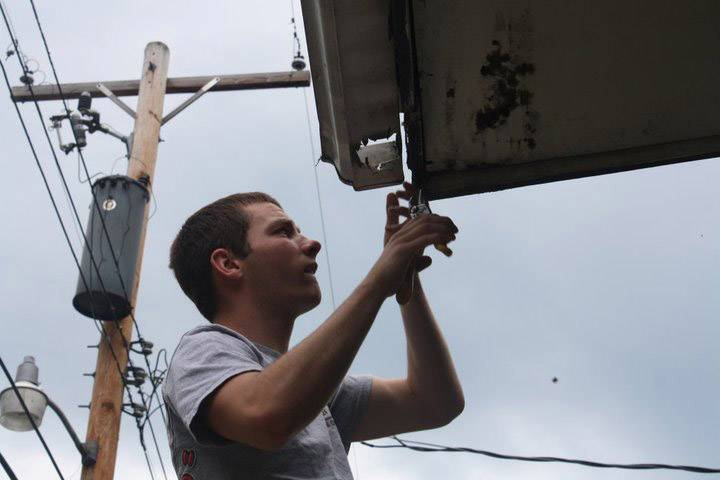 Luke Dettlo replaces a gutter that was causing water damage on a home in Prestonsburg, Kentucky,on a previous trip.