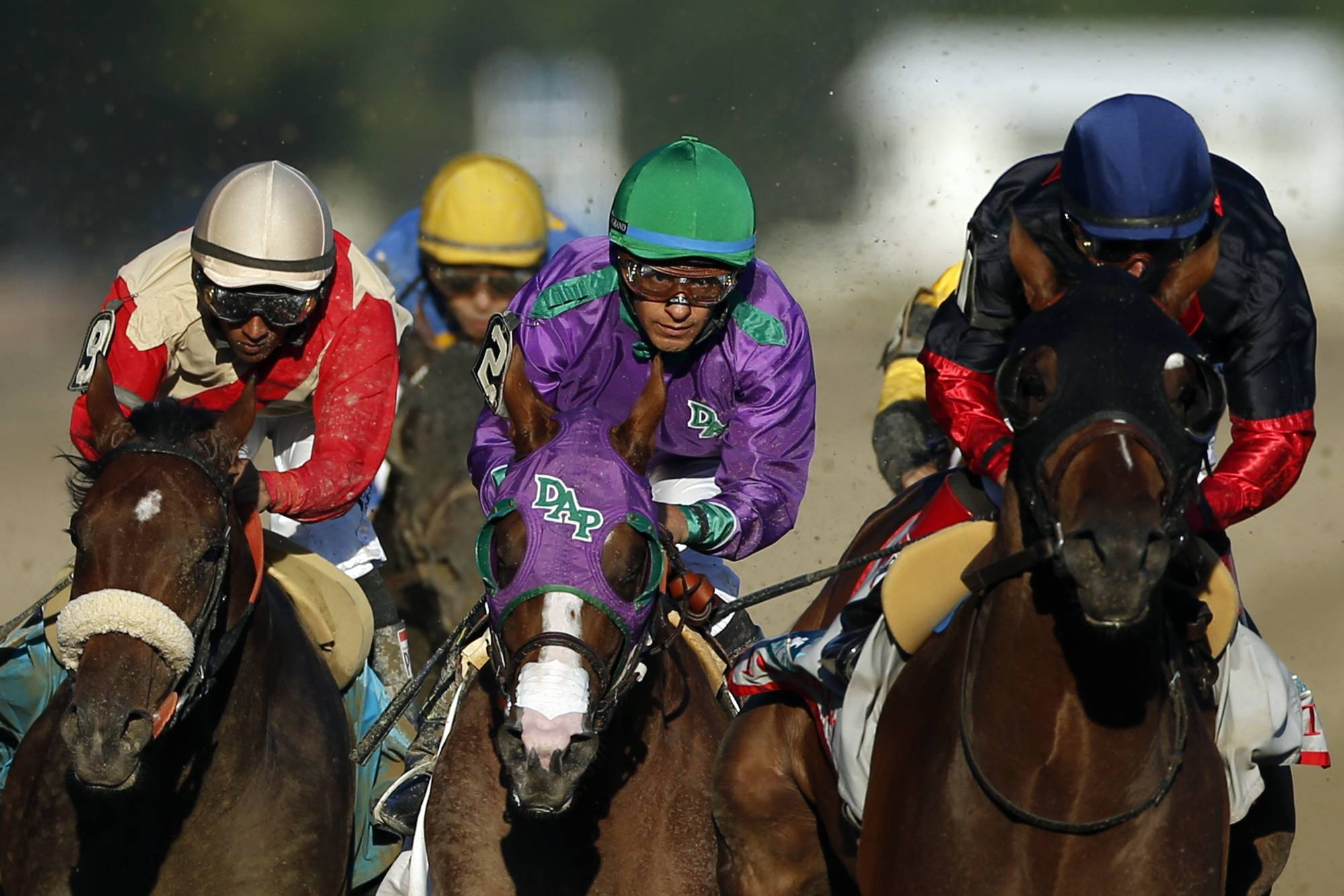 California Chrome, center, is flanked by Wicked Strong, left, and Tonalist, right, as they run down the backstretch during the 146th running of the Belmont Stakes horse race at Belmont Park, Saturday, June 7, 2014, in Elmont, N.Y.  Tonalist went on to win the race, denying California Chrome the Triple Crown victory.