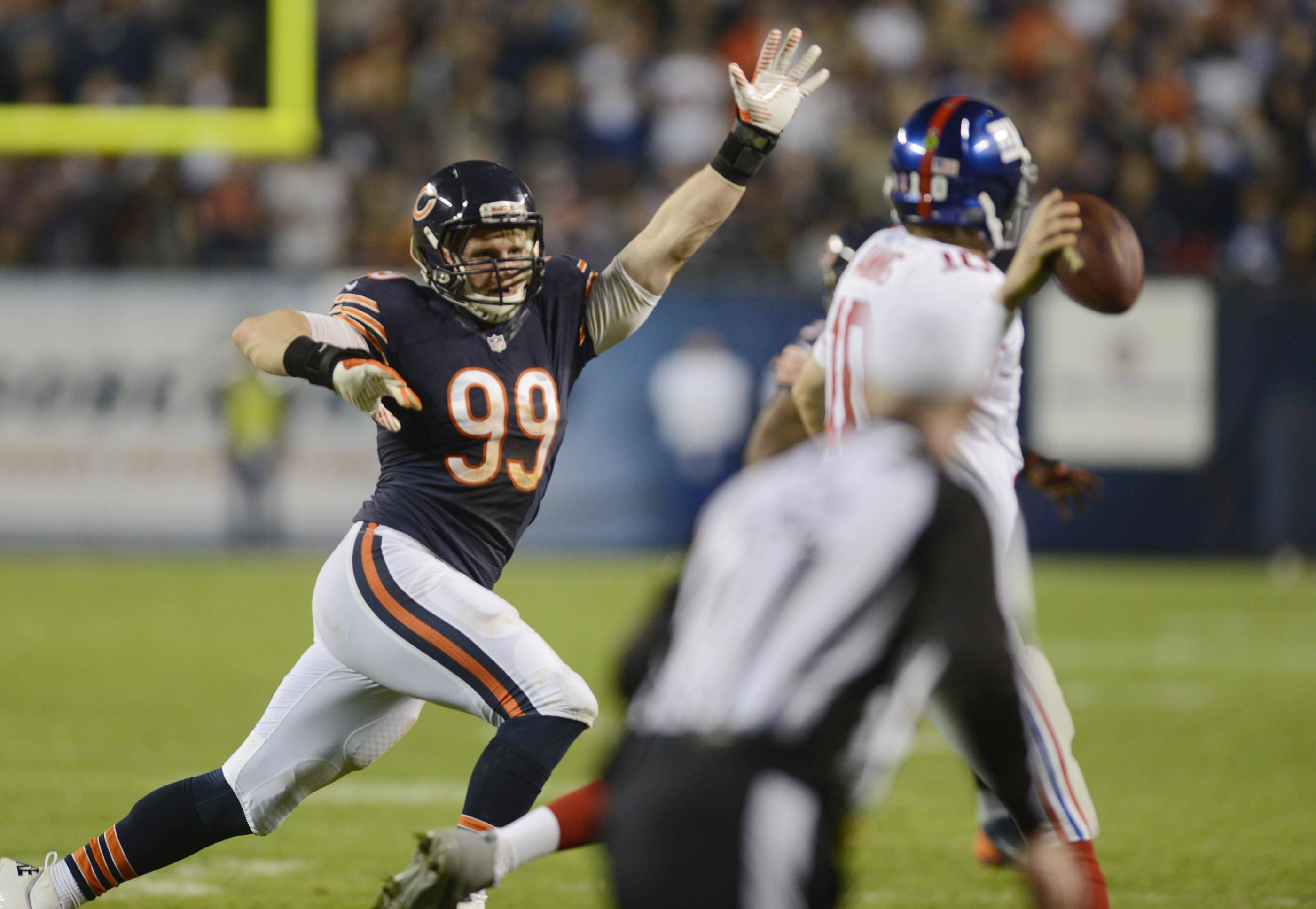 Shea McClellin pressures New York Giants quarterback Eli Manning last season at Soldier Field. McCl