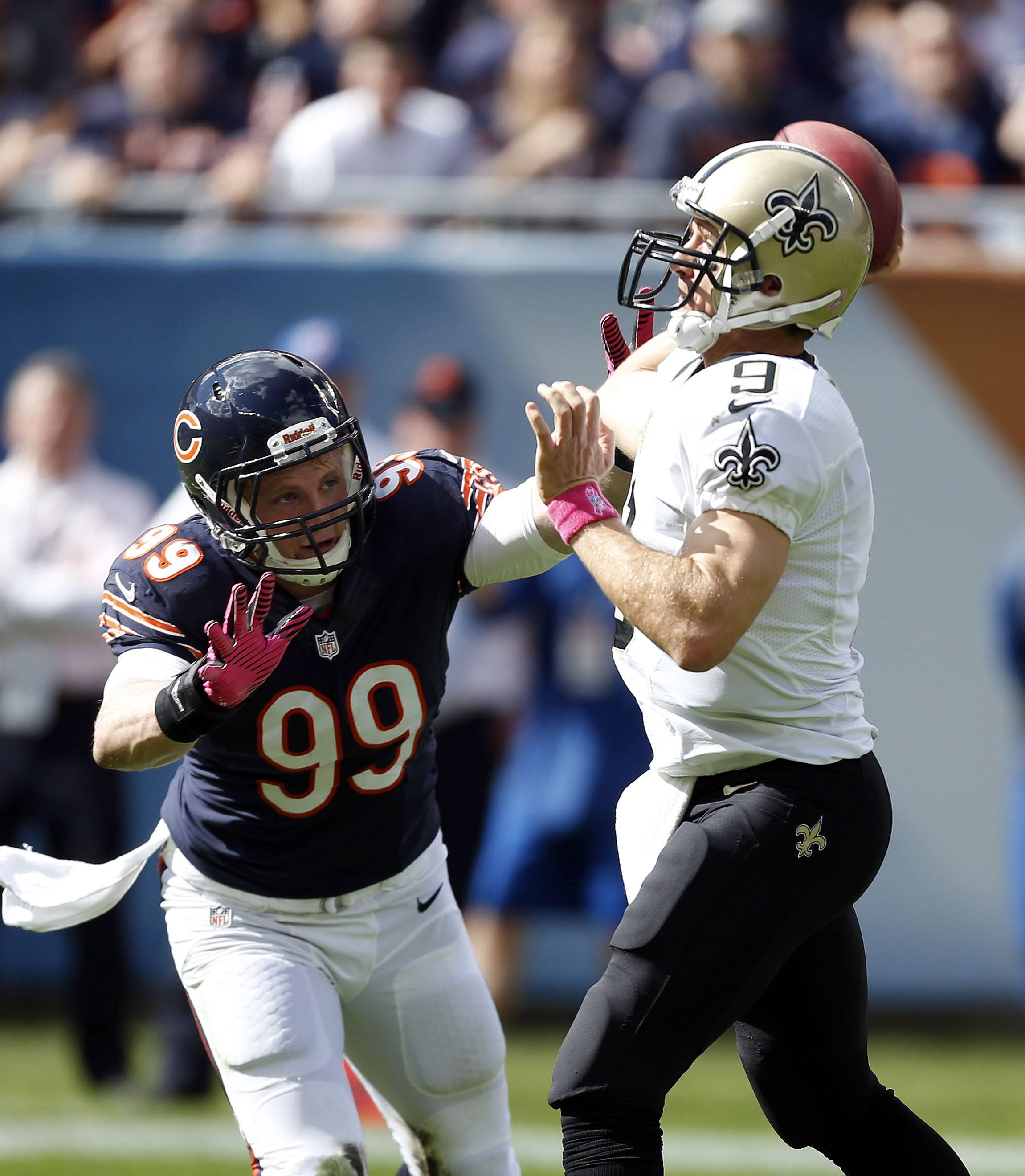 Shea McClellin, here pressuring Saints quarterback Drew Brees last season, will be moving to linebacker in 2014.