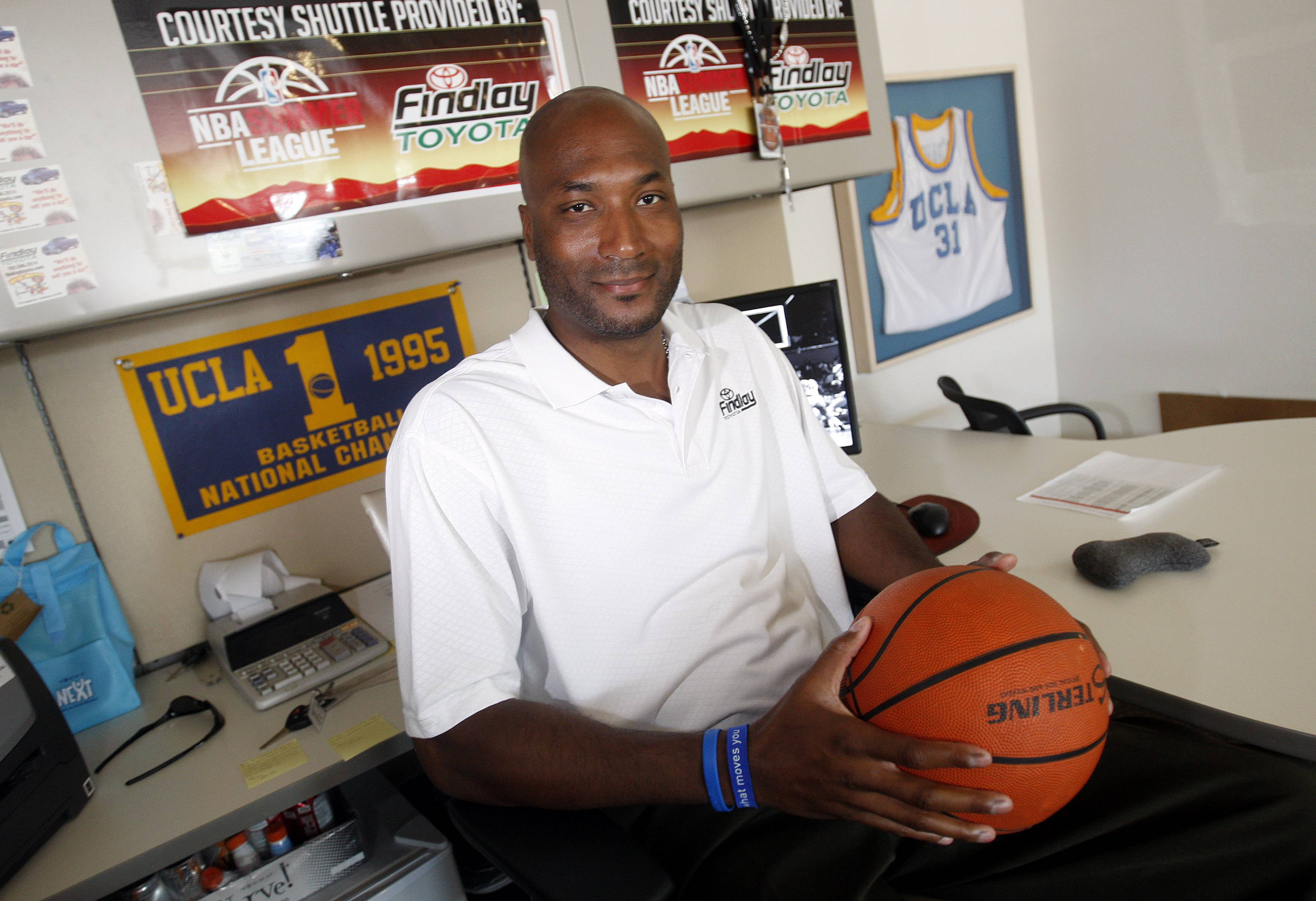 In this Sept. 18, 2010, file photo, former UCLA basketball player Ed O'Bannon Jr. sits in his office in Henderson, Nev.  Five years after the former UCLA star filed his antitrust lawsuit against the NCAA, it goes to trial Monday in a California courtroom.