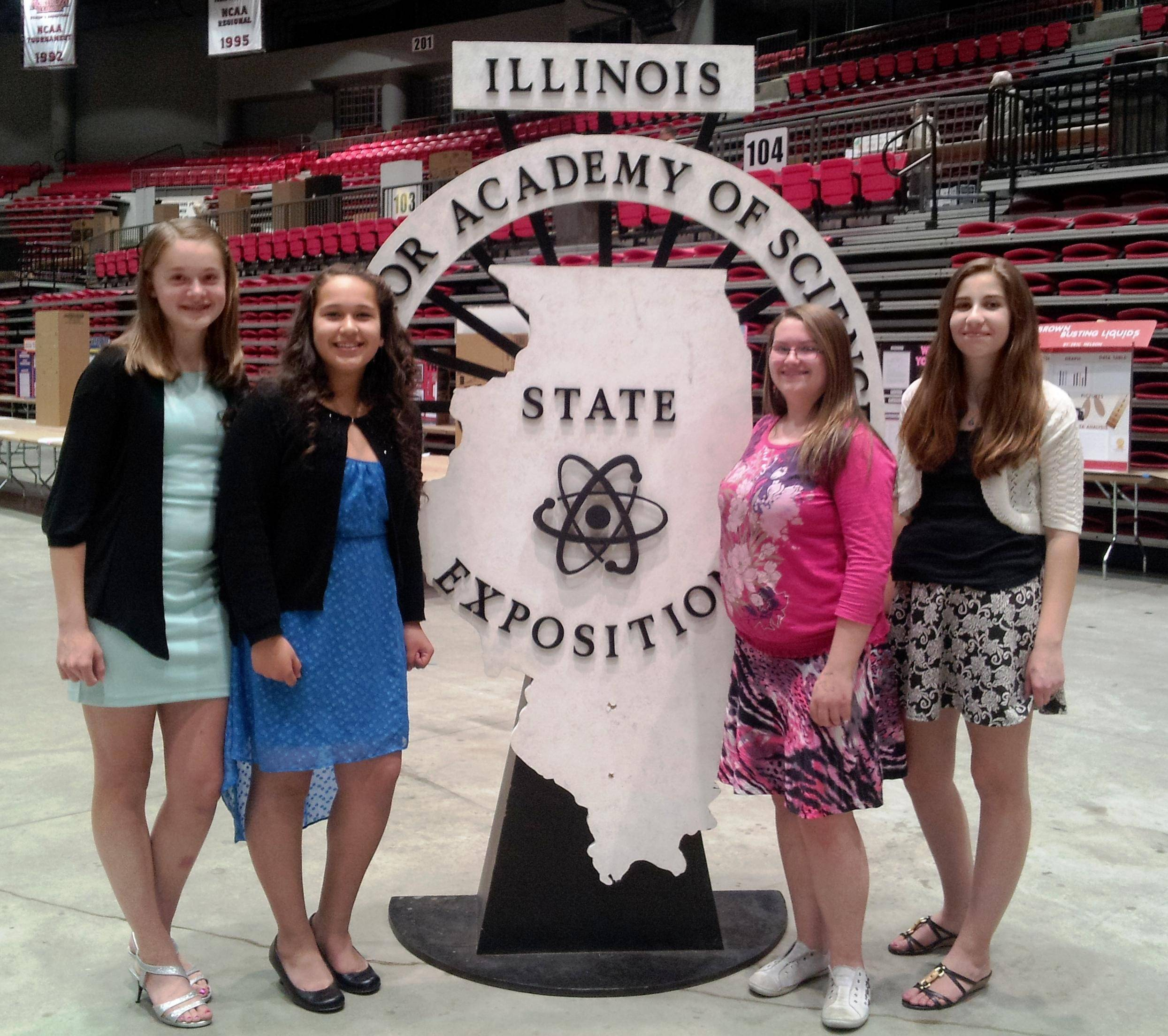Larsen Middle School students, from left, Kylie Graves, Nereida Rosas, Camberlei Lauff, and Madeline Schaeffer, compete at the Illinois Junior Academy of Science State Competition in May.