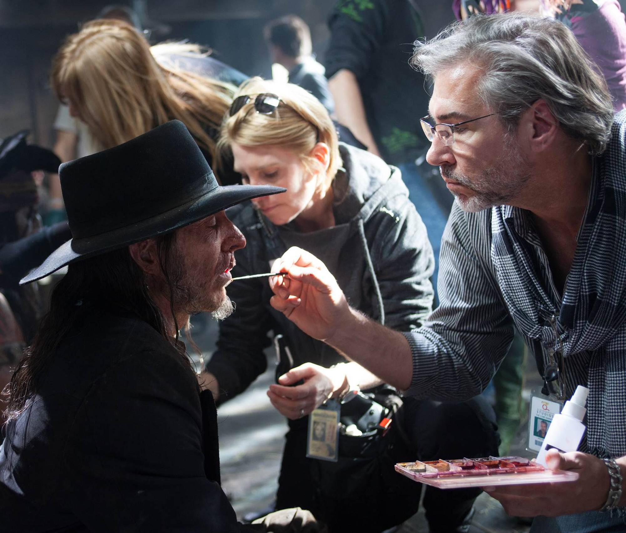 "Mike Smithson, born in Woodstock, applies cosmetics to an actor on the set of the Johnny Depp western comedy ""The Lone Ranger."""