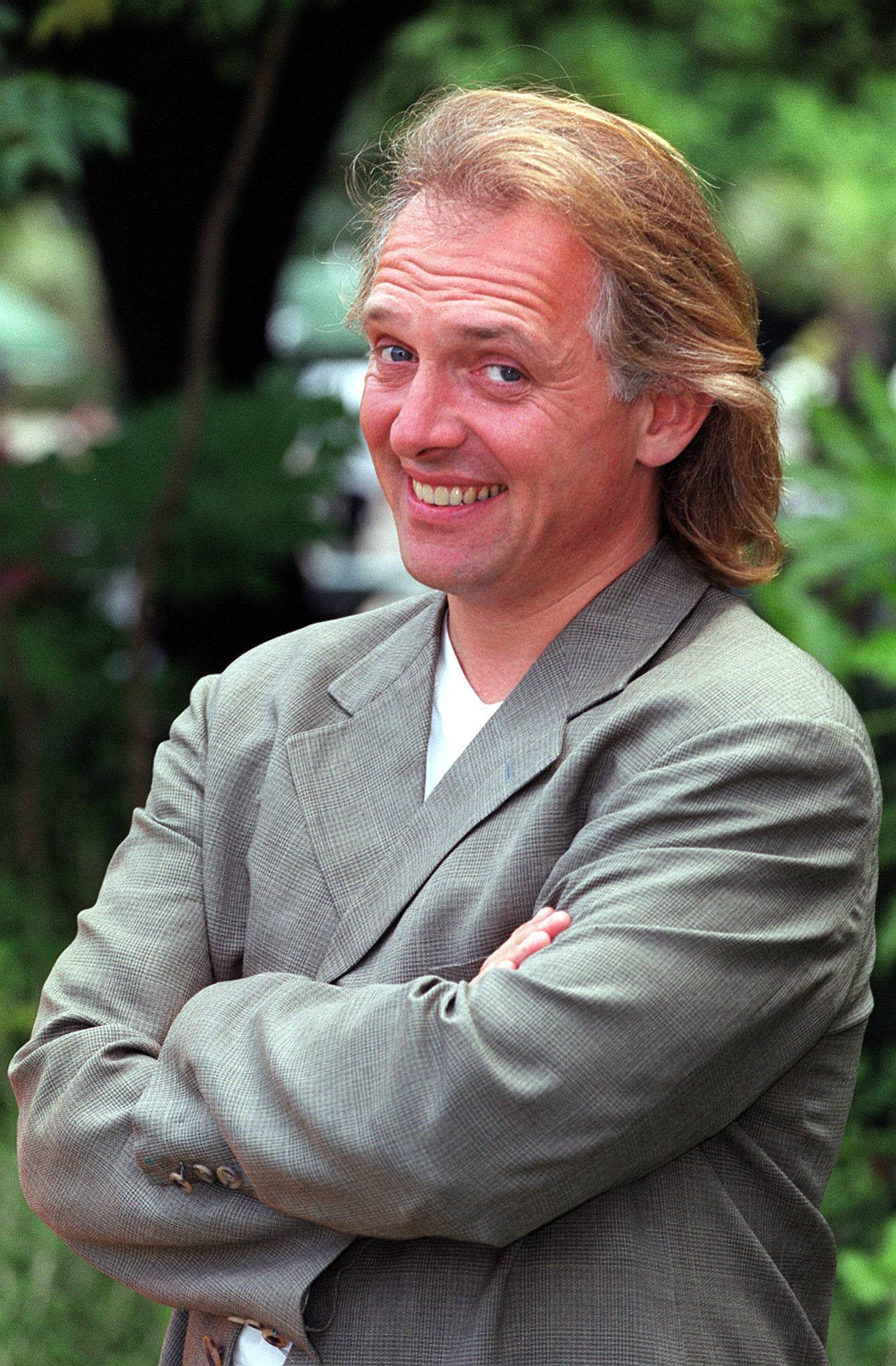 British comedian Rik Mayall, one of a generation of performers who injected post-punk energy into British comedy, has died.