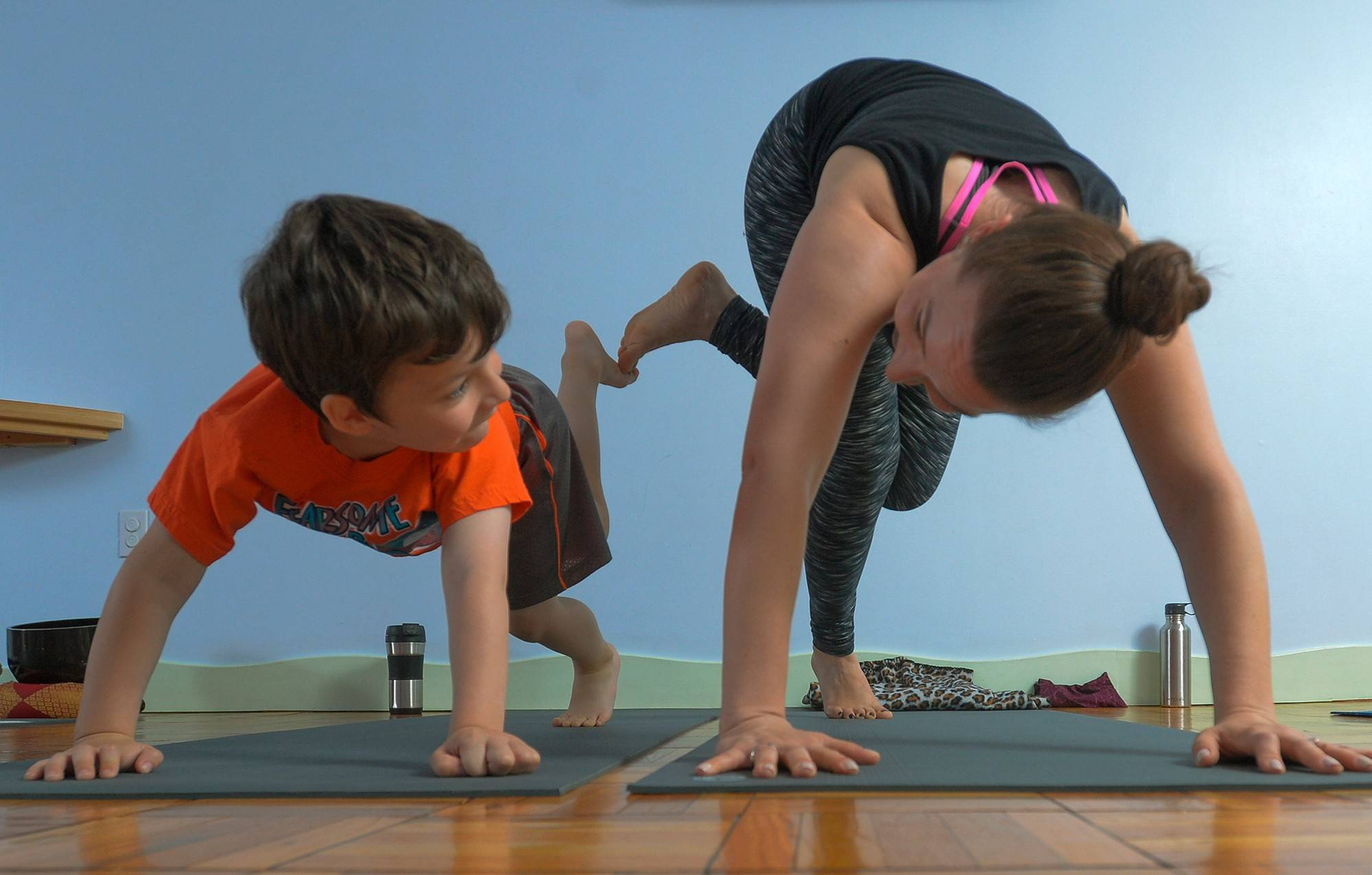 Five-year-old Elias O'Keeffe has no problem keeping up with his mom, Deanna Ortiz, during a family yoga class at Circle Yoga in Washington on a Saturday morning
