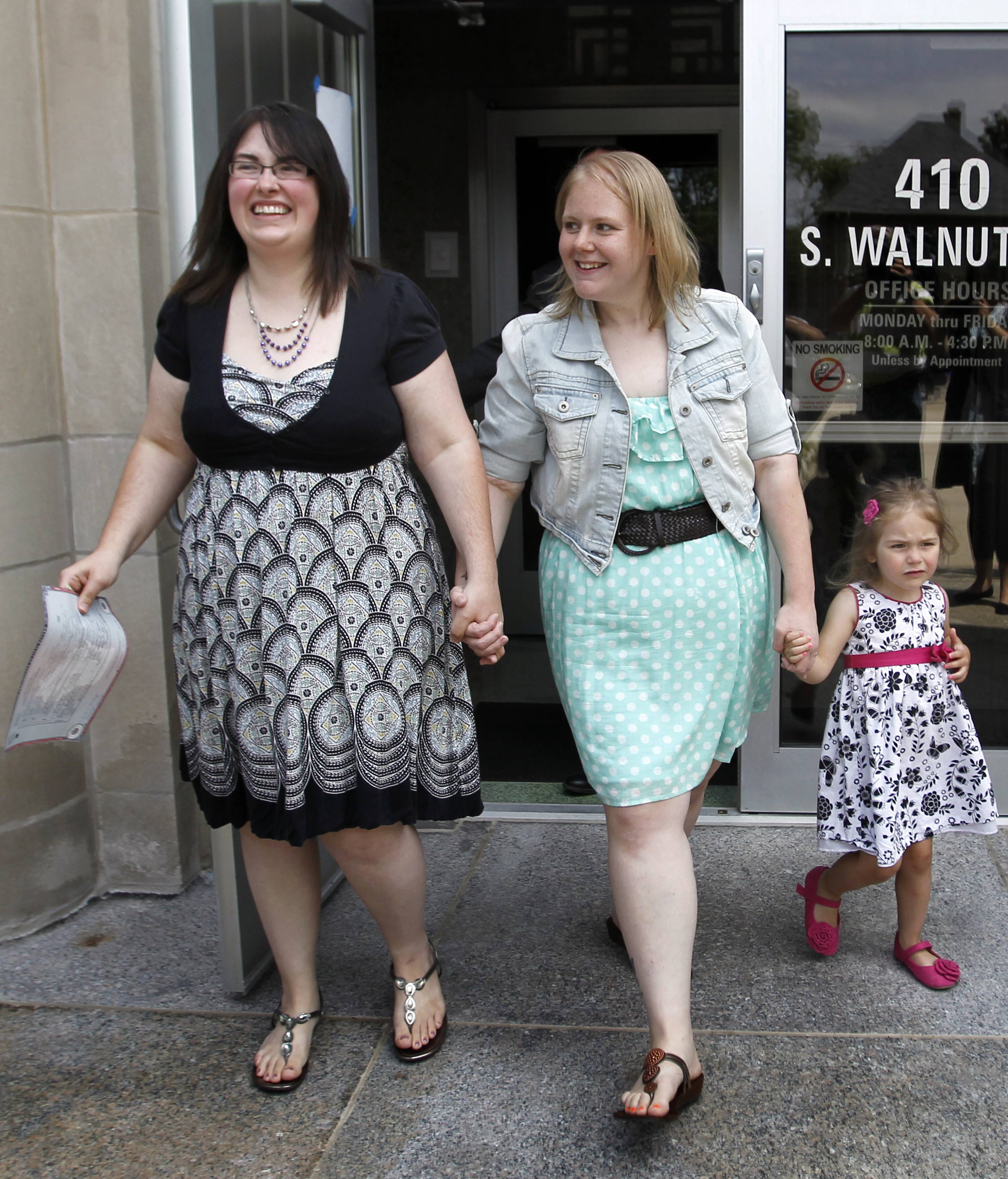 Heather, left, and Natalie Starr, with daughter Libby, were married on the steps of the Outagamie County administration building on Monday in Appleton, Wis. They are the first same-sex couple to be married in the county.