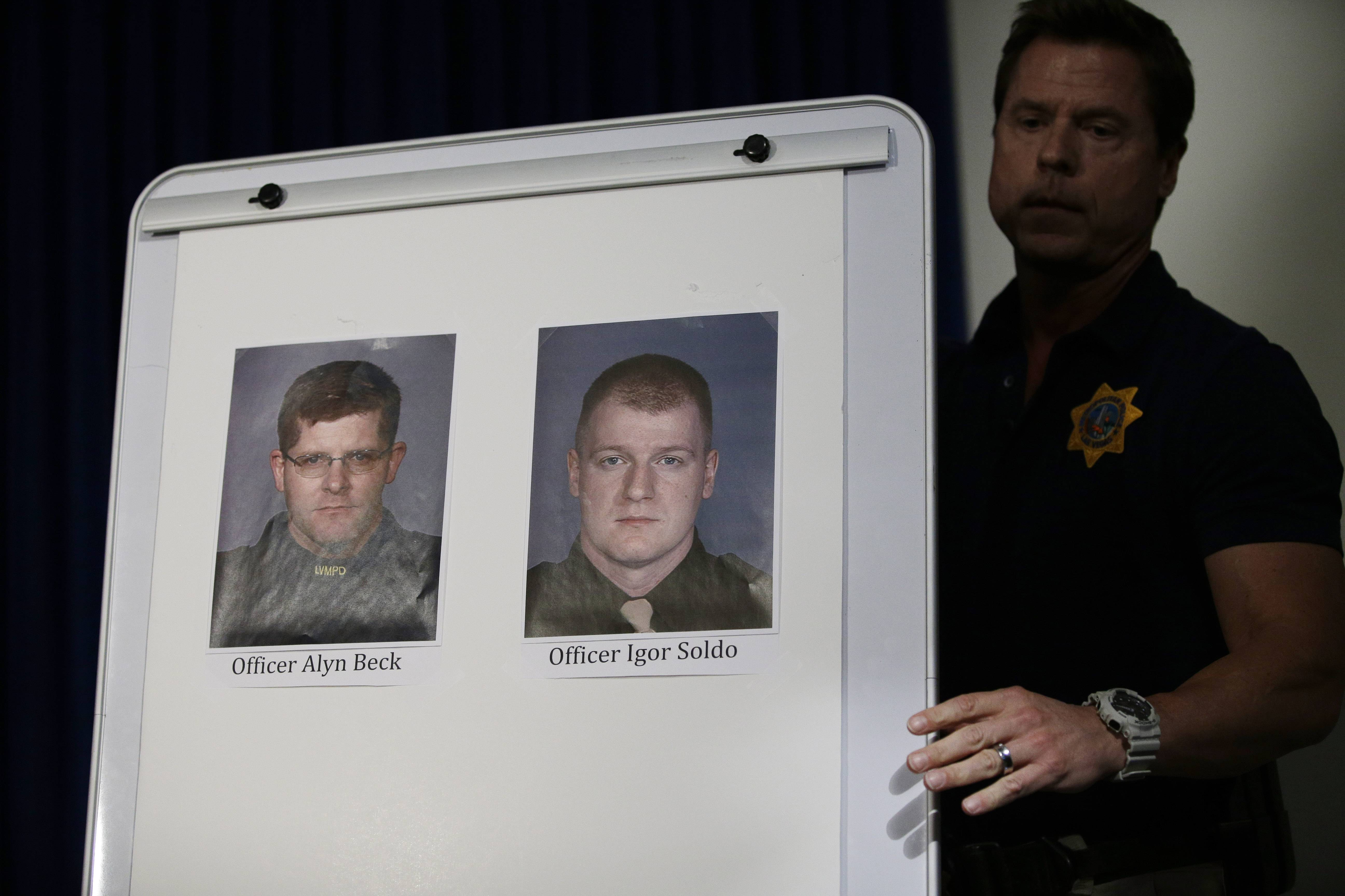Pictures of Las Vegas Metropolitan Police Officers Alyn Beck, left, and Igor Soldo are seen at a news conference Sunday, June 8, 2014 in Las Vegas. The two officers were killed in an ambush while eating lunch.
