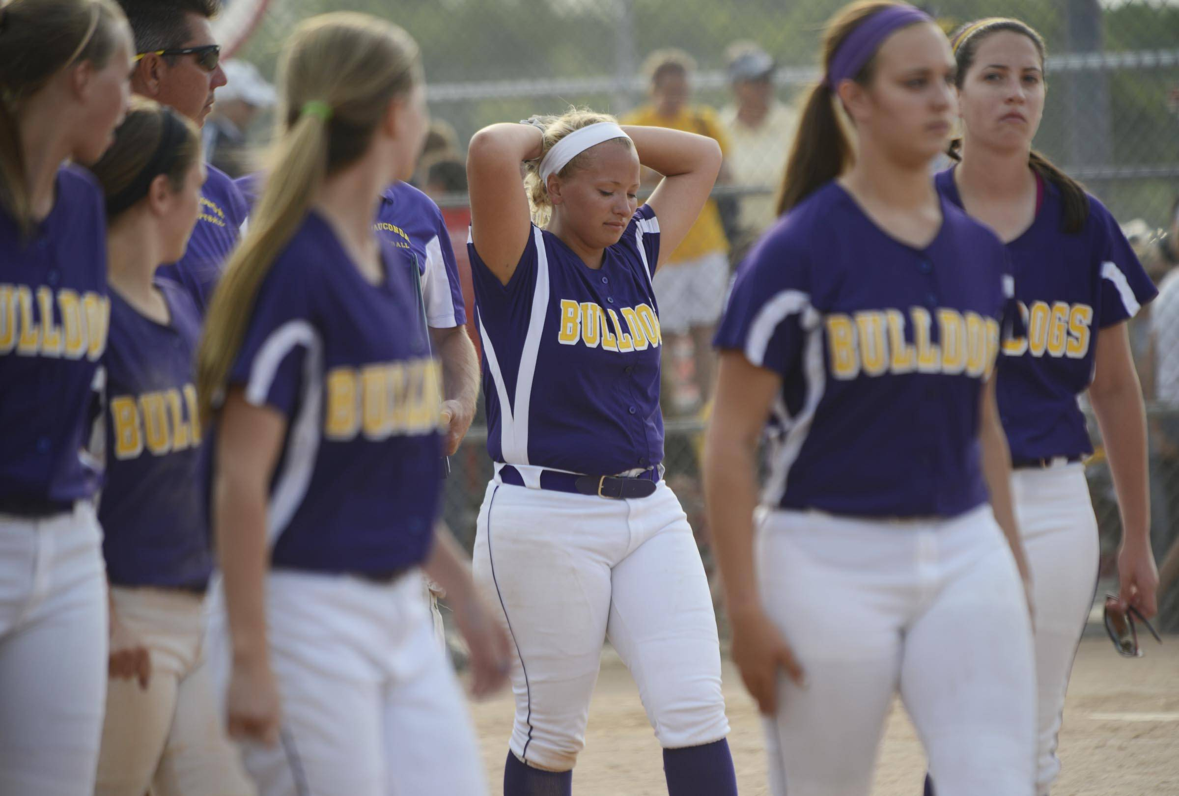 Wauconda's Angie Exline reacts as the team gathers after losing to Sterling in the Class 3A Barrington supersectional Monday.