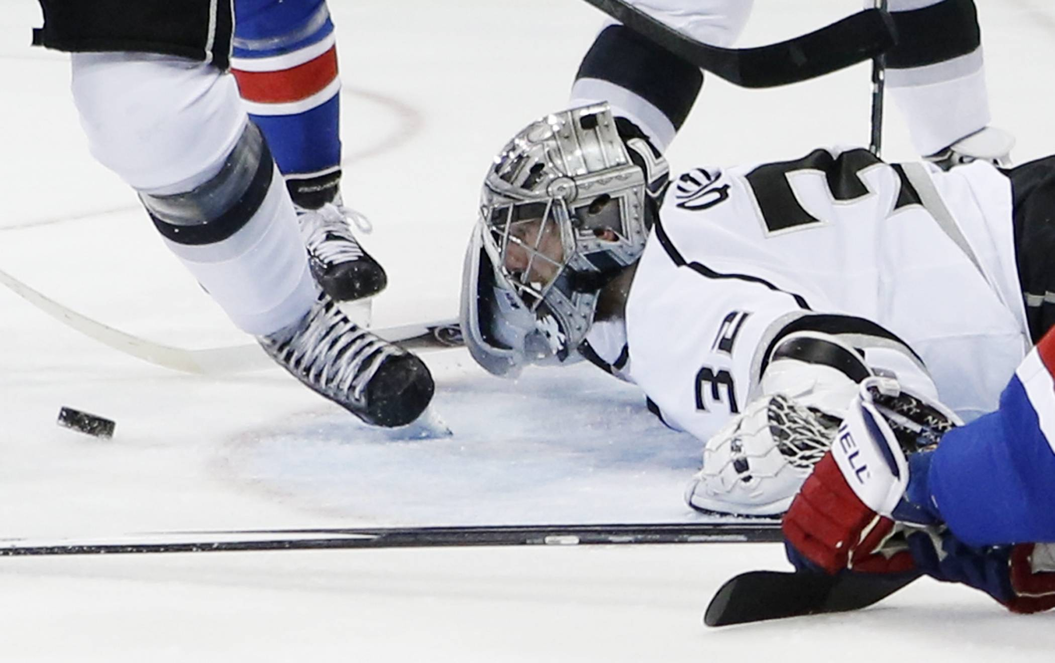 Los Angeles Kings goalie Jonathan Quick follows the rebound after blocking a shot against the New York Rangers in the second period Monday during Game 3 of the Stanley Cup Finals in New York.