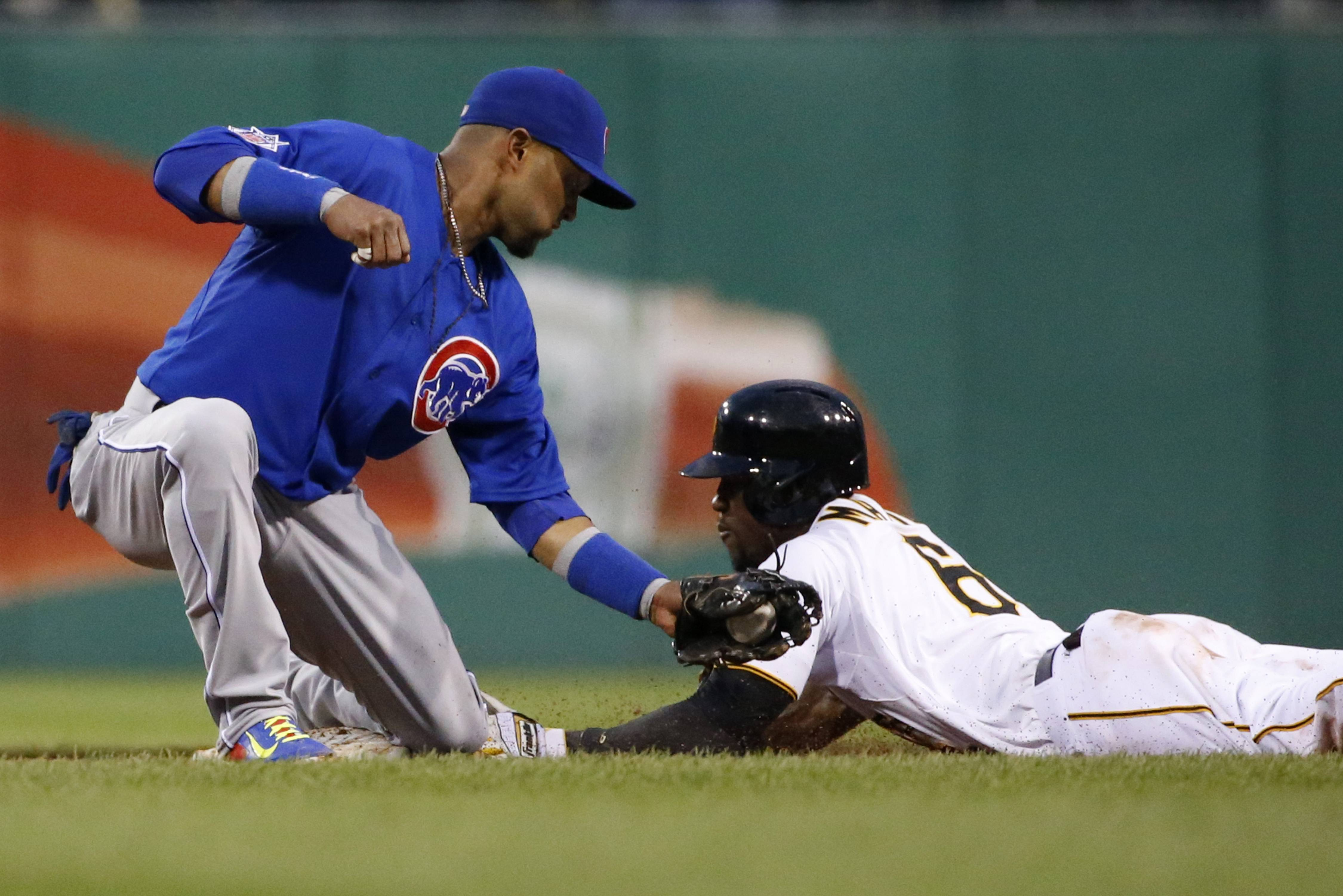 The Pirates' Starling Marte gets to second base ahead of the tag by Cubs second baseman Emilio Bonifacioto during the sixth inning of Monday's game in Pittsburgh.