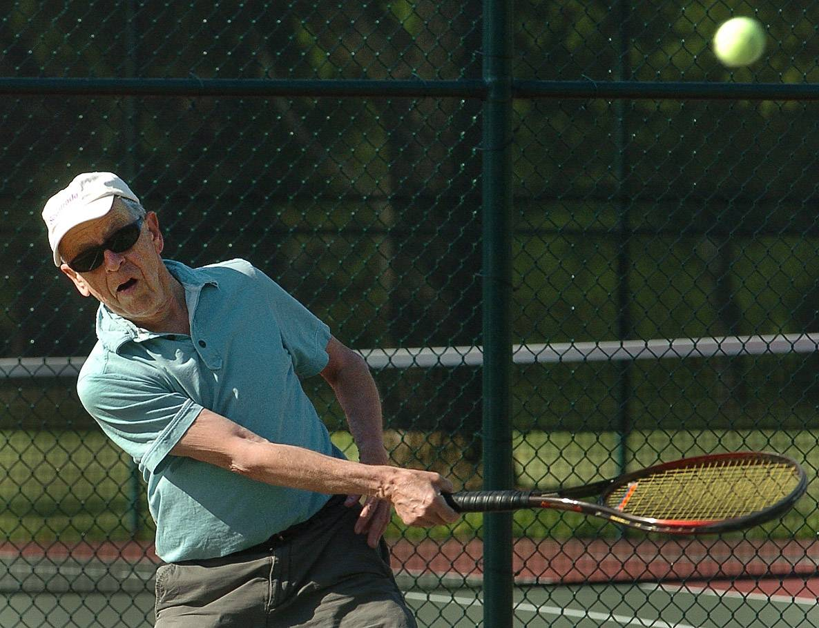 Jim Mooney plays tennis at Lions Park in Mount Prospect. The Arlington Heights resident found that retiring to a different state and community was not for him.