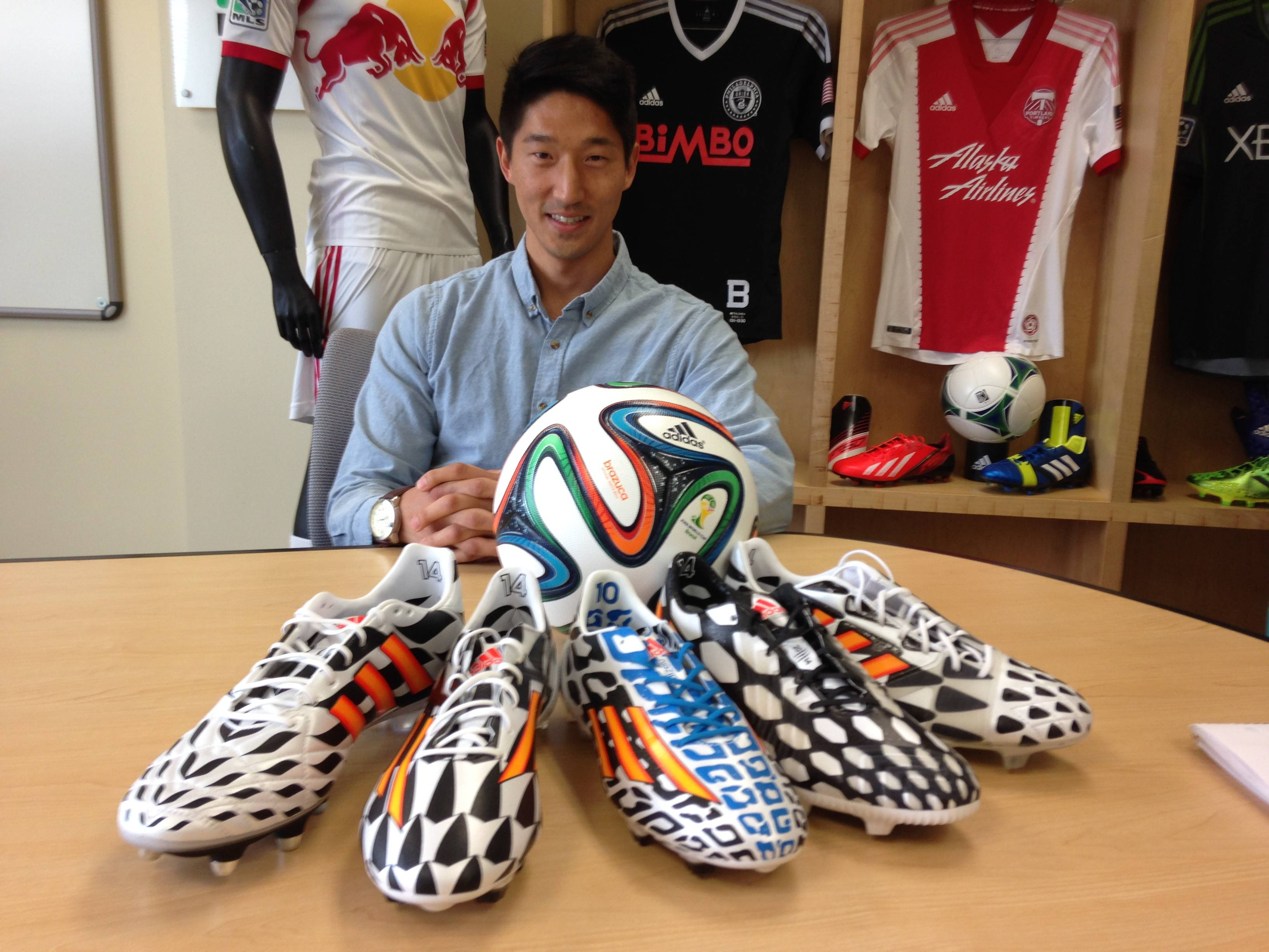 Peter Hong, merchandise manager for adidas, with the company's Battle Pack collection of soccer boots and the Brazuca, the official ball of the 2014 World Cup, at the conpany's headquarters in Portland, Ore.