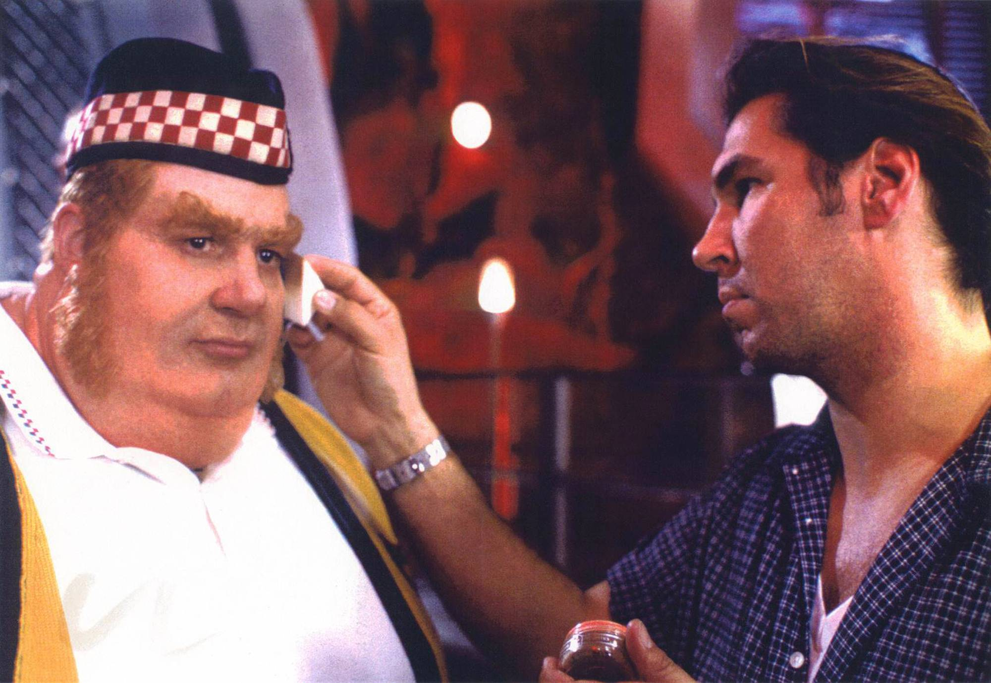 "Mike Smithson applies makeup to Mike Myers' rotund villain for the movie ""Austin Powers: The Spy Who Shagged Me."""