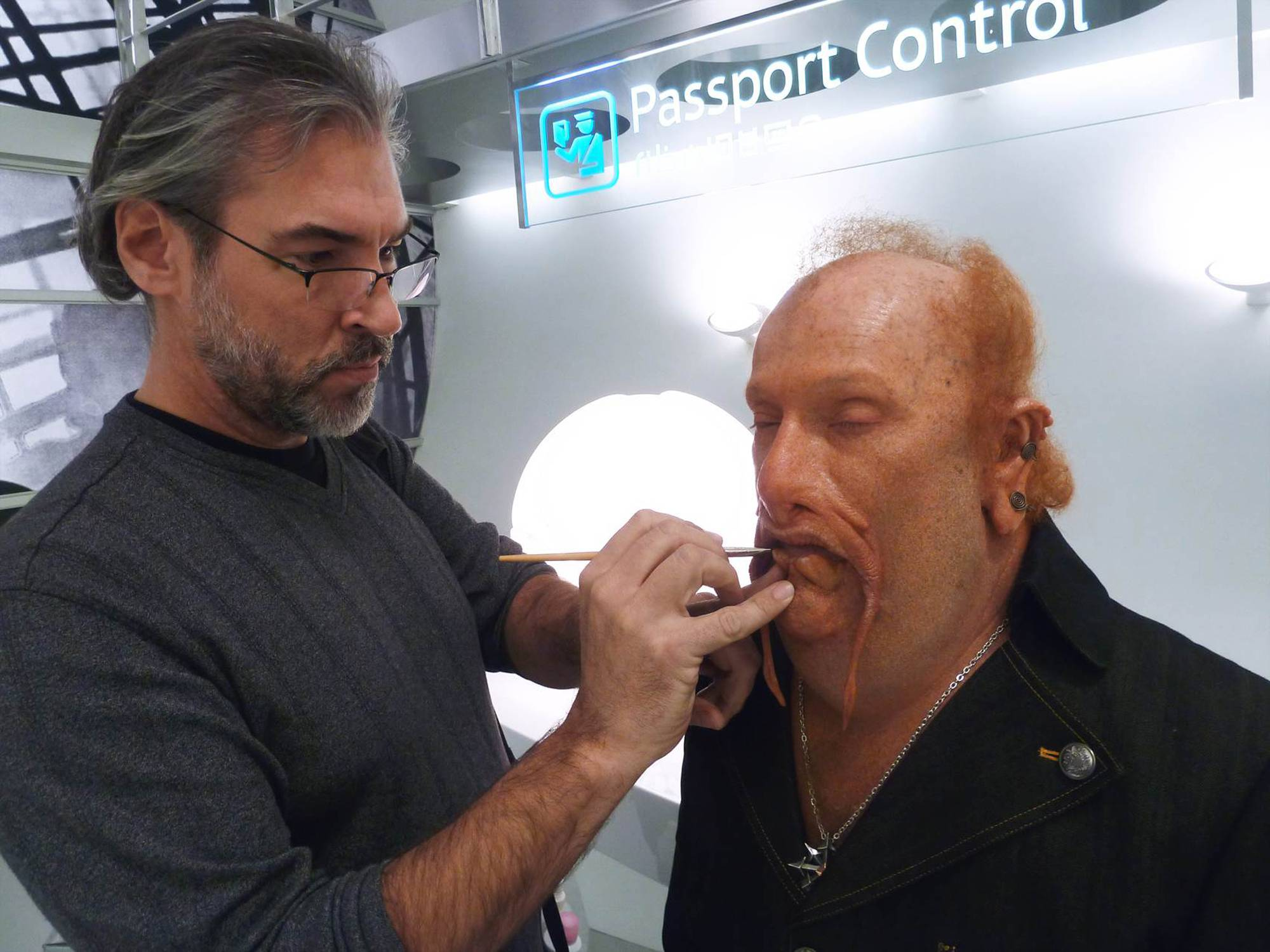 "Former McHenry resident Mike Smithson puts the final touches on an actor playing an alien in ""Men in Black III."""