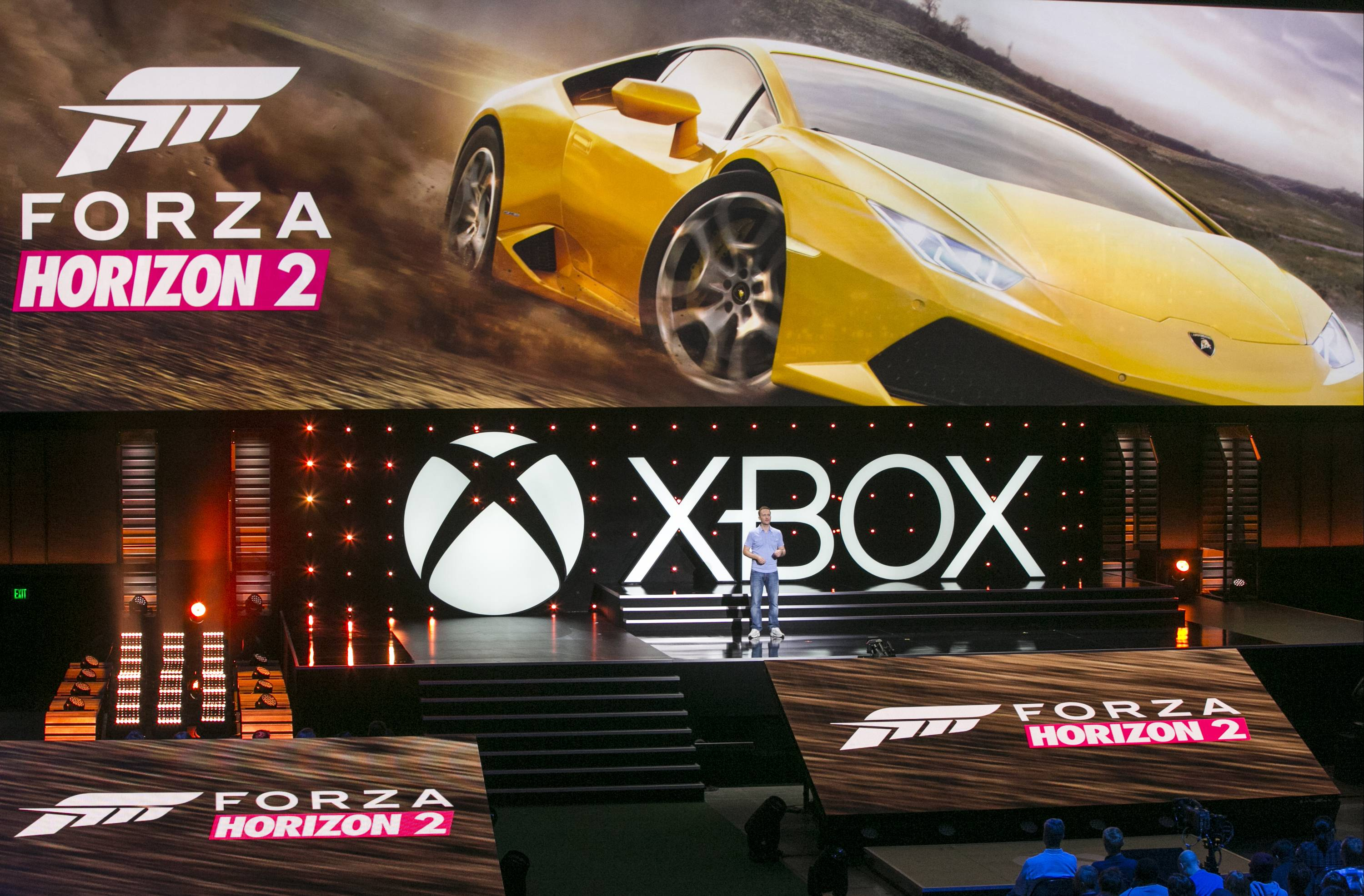 "Ralph Fulton, Playground Games Founder and Creative Director, presents ""Forza Horizon 2,"" an upcoming video game for the Xbox One during the Xbox presentation ahead of the Electronic Entertainment Expo at the University of Southern California's Galen Center on Monday in Los Angeles. With the launch of the Xbox One, PlayStation 4 and Wii U in the video game industry's rearview mirror, the spotlight at E3 is expected to shift back to games."