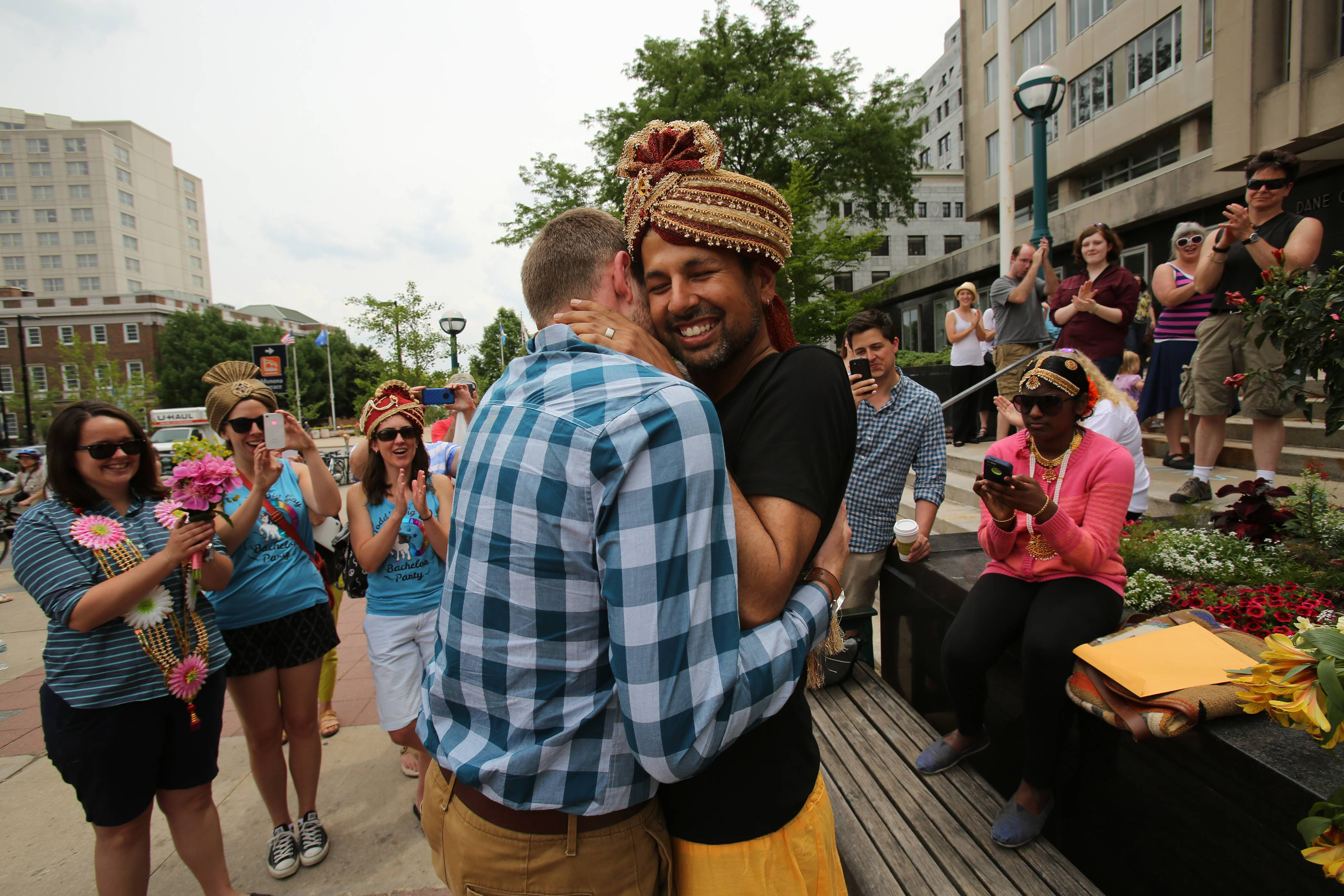 Todd Kinsman, 28, left, and Ravi Manghnani, 37, hug after getting married outside the Madison City-County Building on Saturday, the day after the ban on same-sex marriage was struck down in Wisconsin.