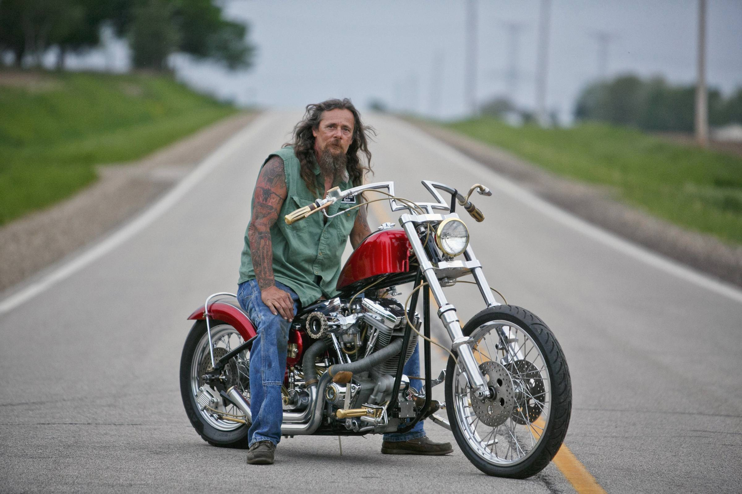 Associated PressCarl Pusser, of East Peoria,  owner of Walkin' Tall Cycles in Tremont on a custom built bike that he's been working on for over a year for a man in Pekin.