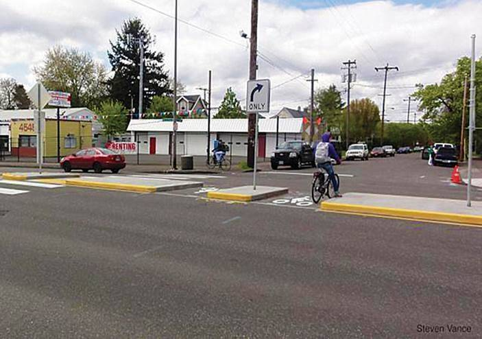 "Street-level ""refuges"" at medians can assist cyclists on busy roads."