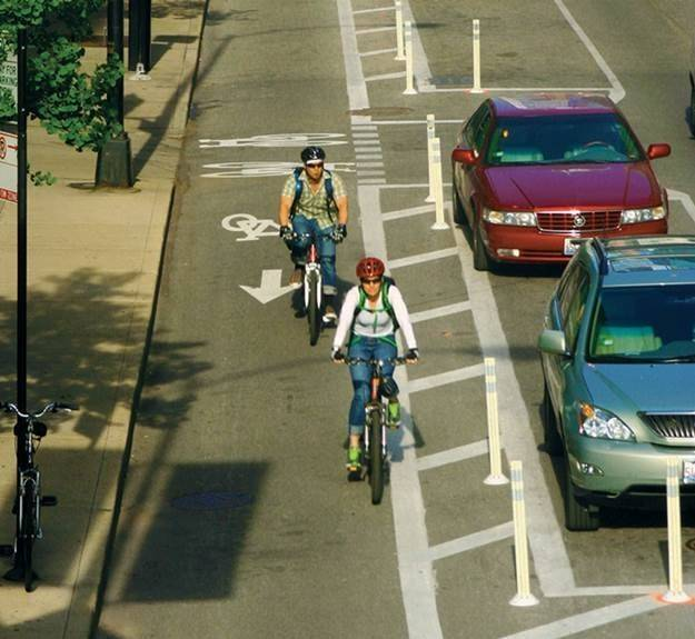 Bike boulevards with posts protecting riders from vehicles can encourage more people to cycle, advocates say.
