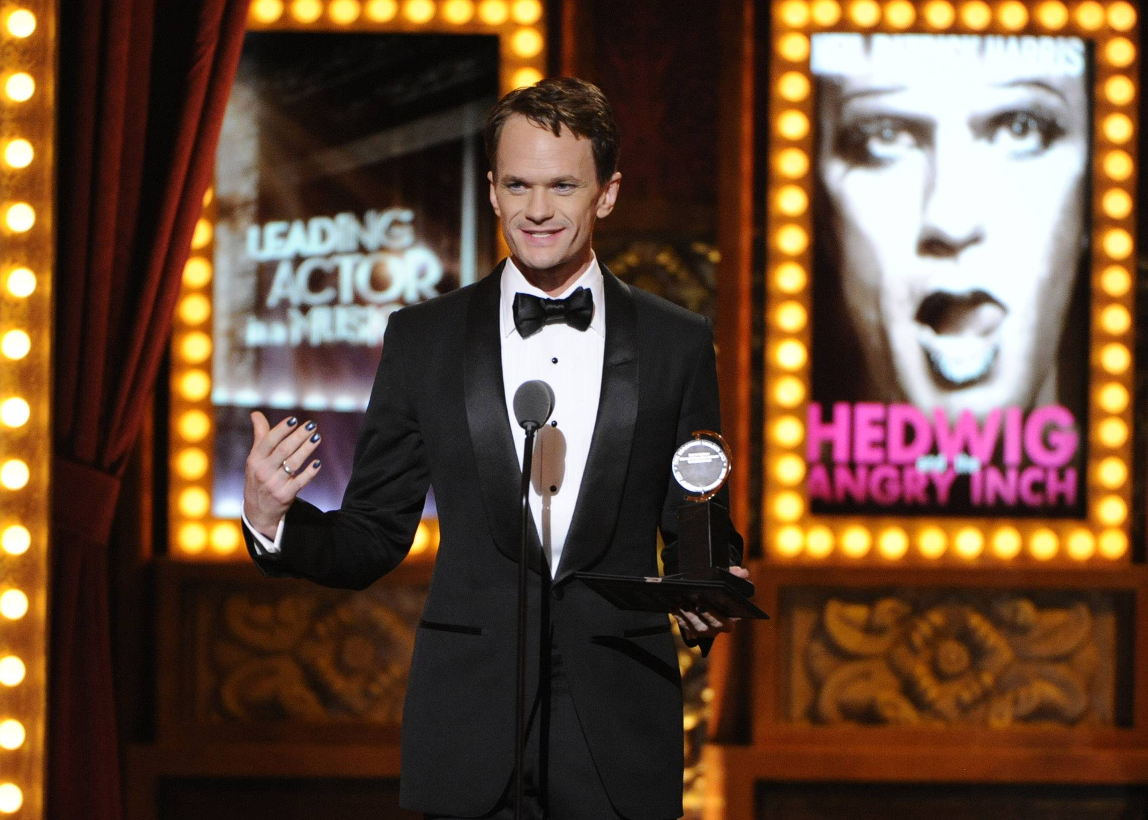 "Neil Patrick Harris trades in hosting duties this year for some hardware as he accepts the award for best performance by an actor in a leading role in a musical for ""Hedwig and the Angry Inch"" on Sunday at the 68th annual Tony Awards at Radio City Music Hall in New York."