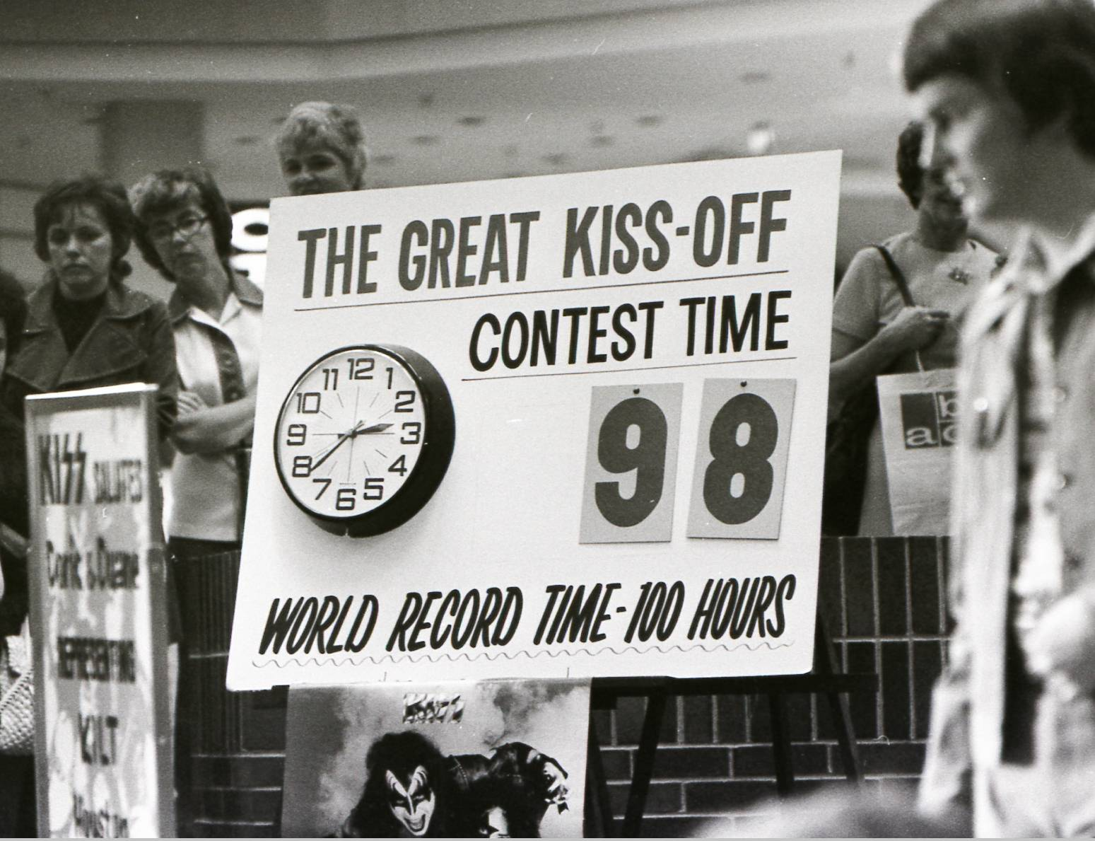 "A clock shows ""The Great Kiss Off"" kissing contest at Woodfield Mall in June 1974 is closing in on the then record of 100 hours."