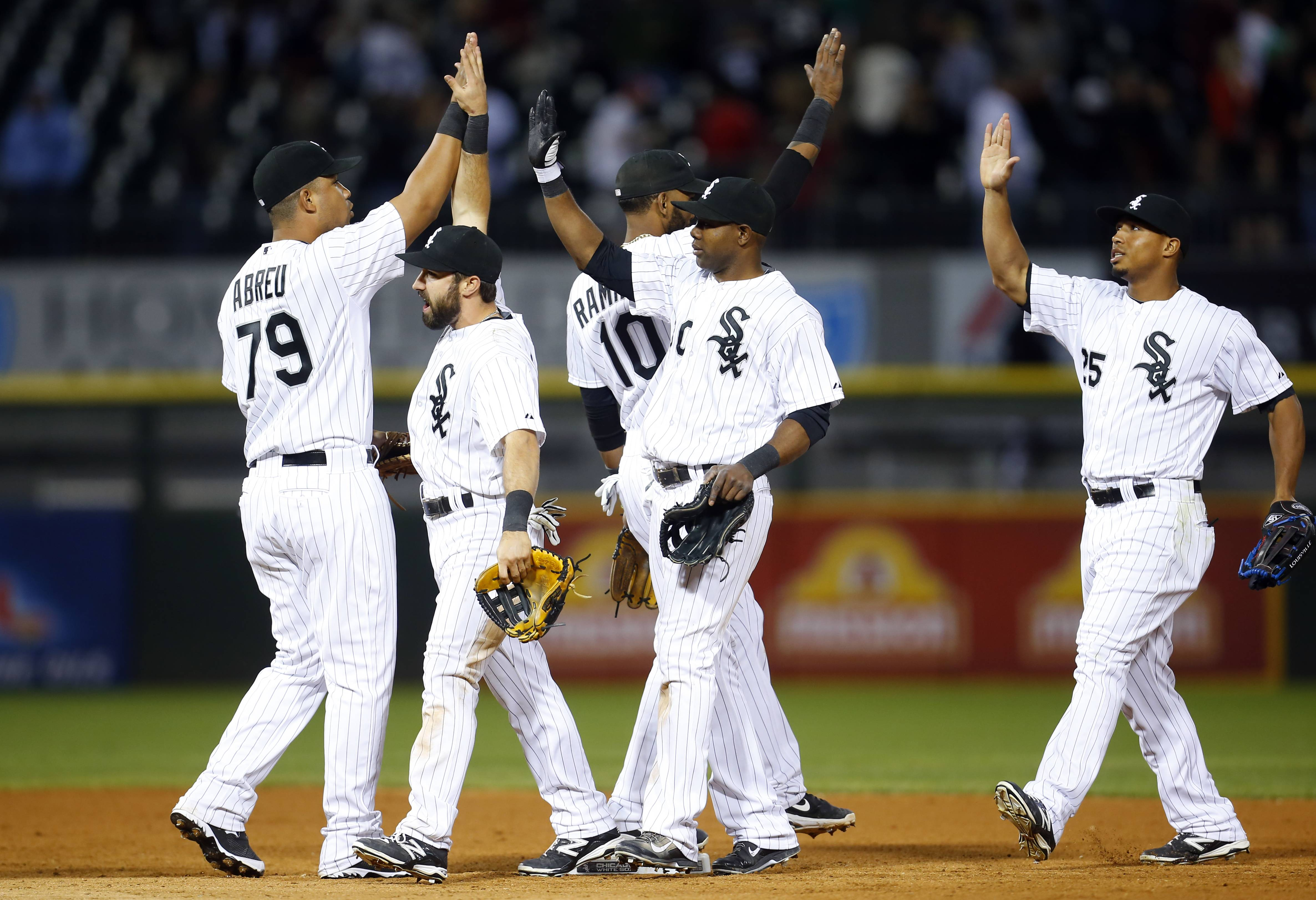 The White Sox celebrate after defeating the Detroit Tigers 6-5 on Monday night.