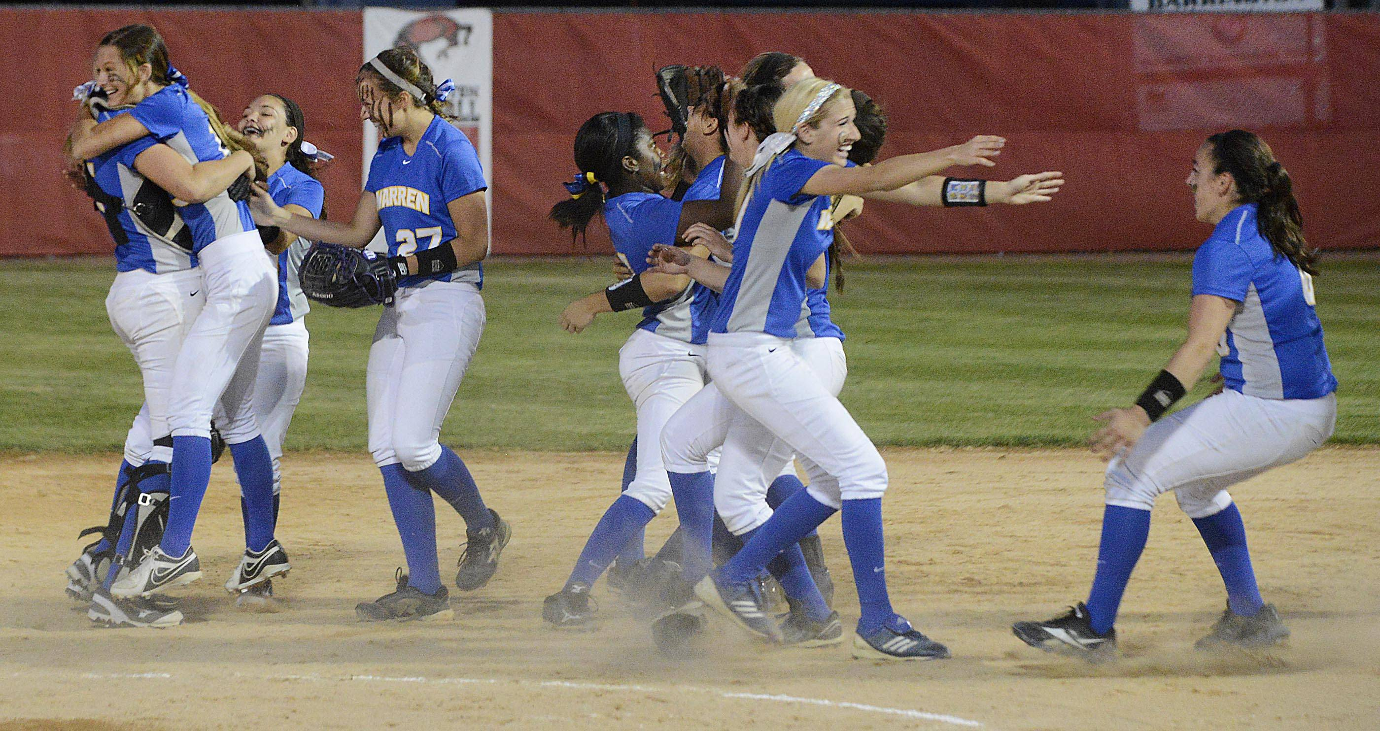 Warren celebrates its 3-1 win over Barrington in the Class 4A Barrington supersectional Monday.