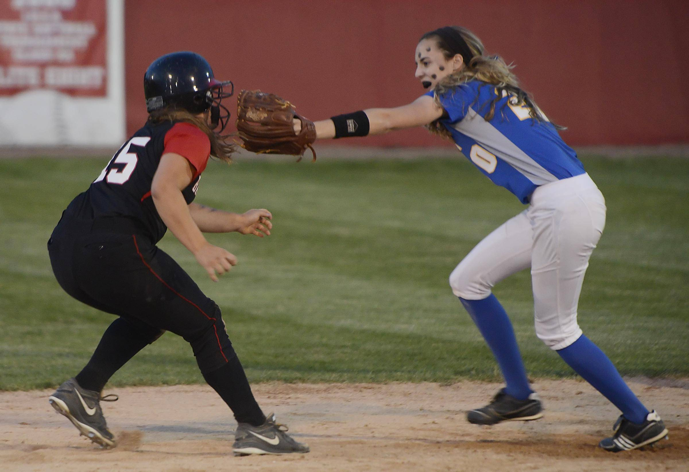Warren's Shannon McKeon catches Barrington's Rachel Macdonald off second base and tags her out to end the sixth inning in the Class 4A Barrington supersectional Monday.