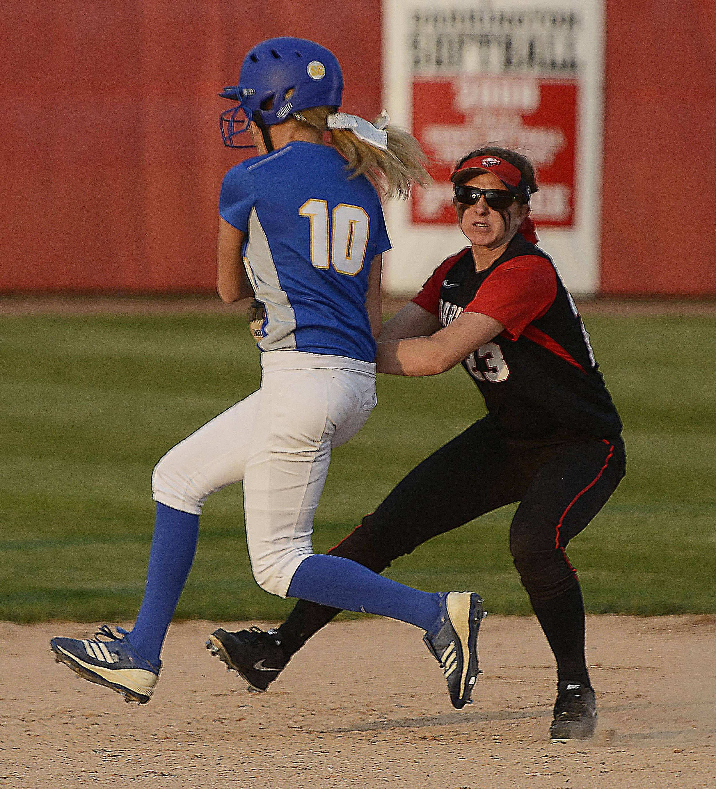 Barrington's Kelly Katis tags out Warren's Michelle Vasen in the Class 4A Barrington supersectional Monday.