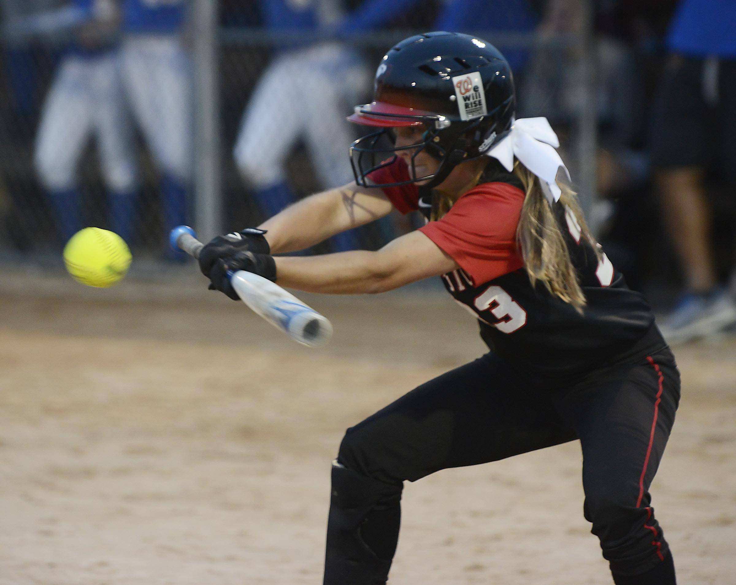 Warren's Barrington's Carly Kordich lays down a bunt to advance a runner in the Class 4A Barrington supersectional Monday.