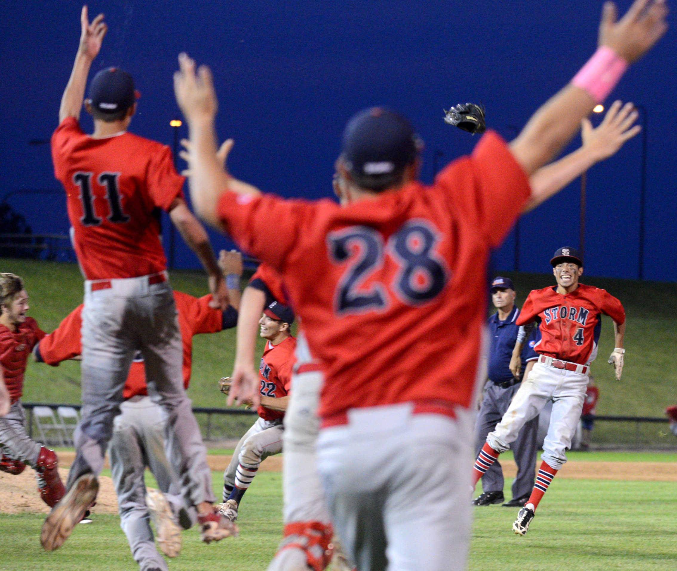 South Elgin's players celebrate after the final out of a 7-6 win over Evanston during the Class 4A supersectional baseball game at Boomers Stadium in Schaumburg on Monday night.