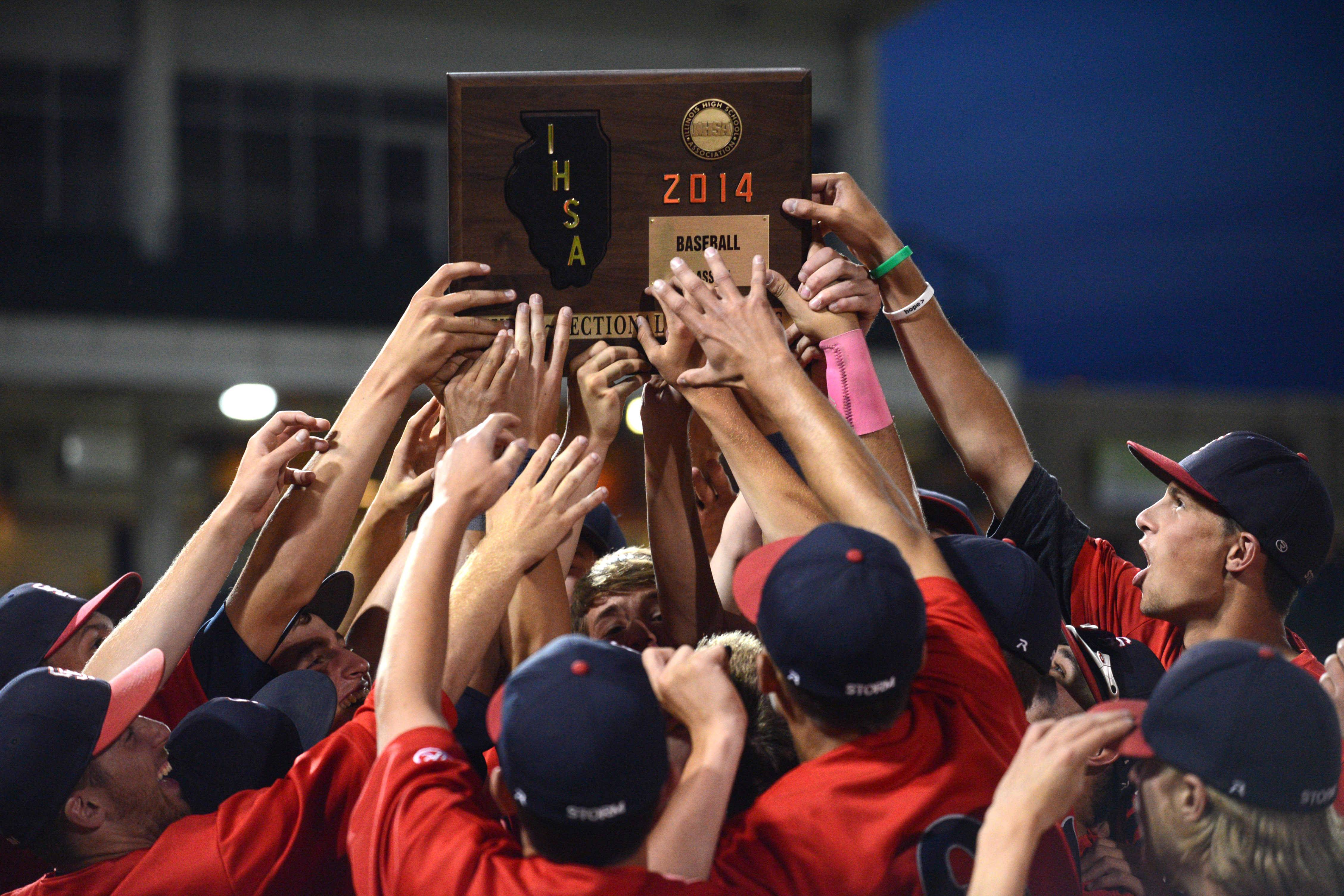 South Elgin's players hoist their hardware after a 7-6 win over Evanston during the Class 4A supersectional baseball game at Boomers Stadium in Schaumburg on Monday night.