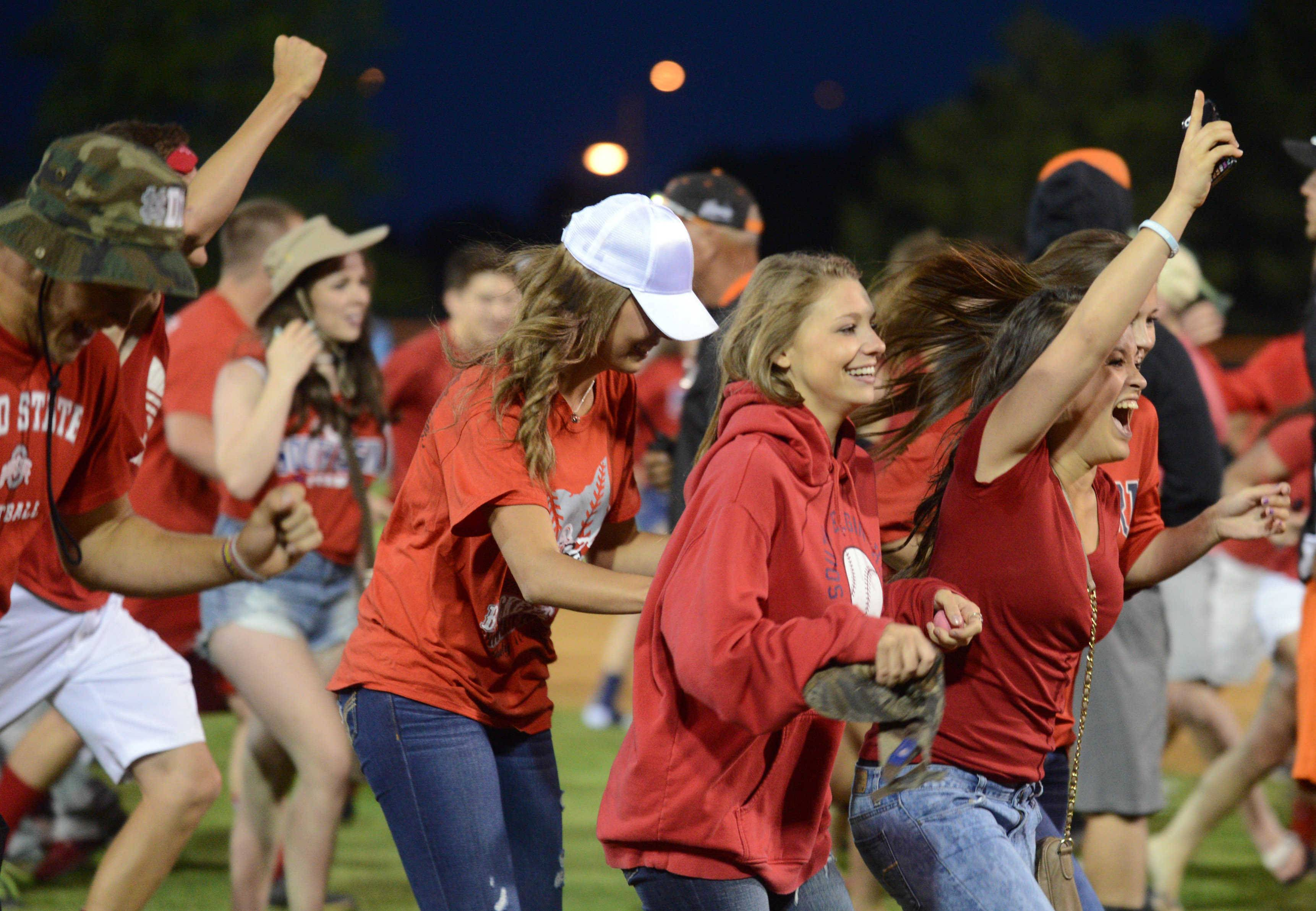 South Elgin's fans celebrate by rushing on the field after a 7-6 win over Evanston during the Class 4A supersectional baseball game at Boomers Stadium in Schaumburg on Monday night.
